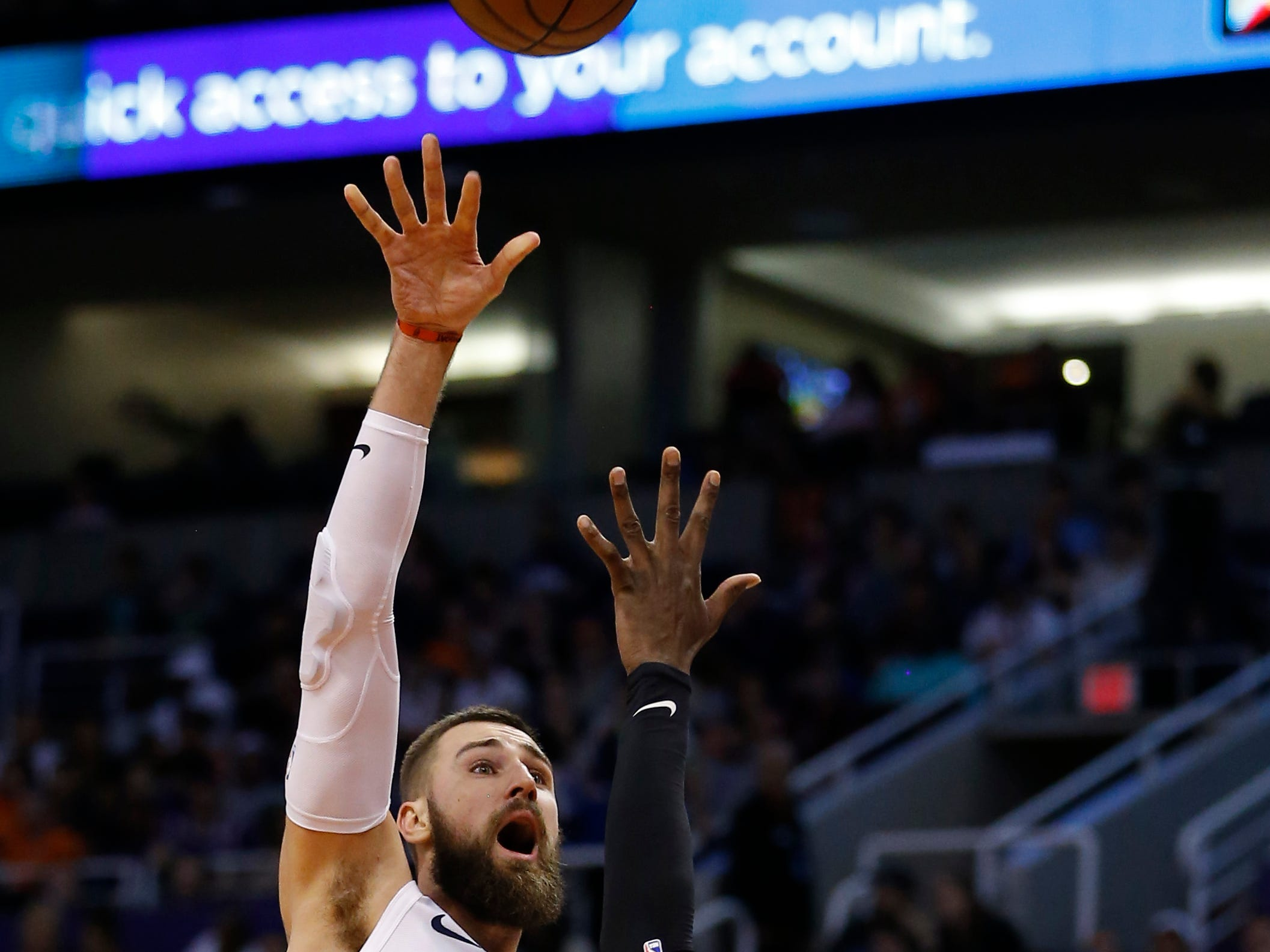 Memphis Grizzlies center Jonas Valanciunas, left, shoots over Phoenix Suns center Deandre Ayton, left, in the first half during an NBA basketball game, Saturday, March 30, 2019, in Phoenix. (AP Photo/Rick Scuteri)