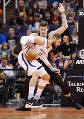 Mar 30, 2019; Phoenix, AZ, USA; Memphis Grizzlies center Jonas Valanciunas (17) dribbles against Phoenix Suns forward Dragan Bender (35) during the first half at Talking Stick Resort Arena. Mandatory Credit: Joe Camporeale-USA TODAY Sports