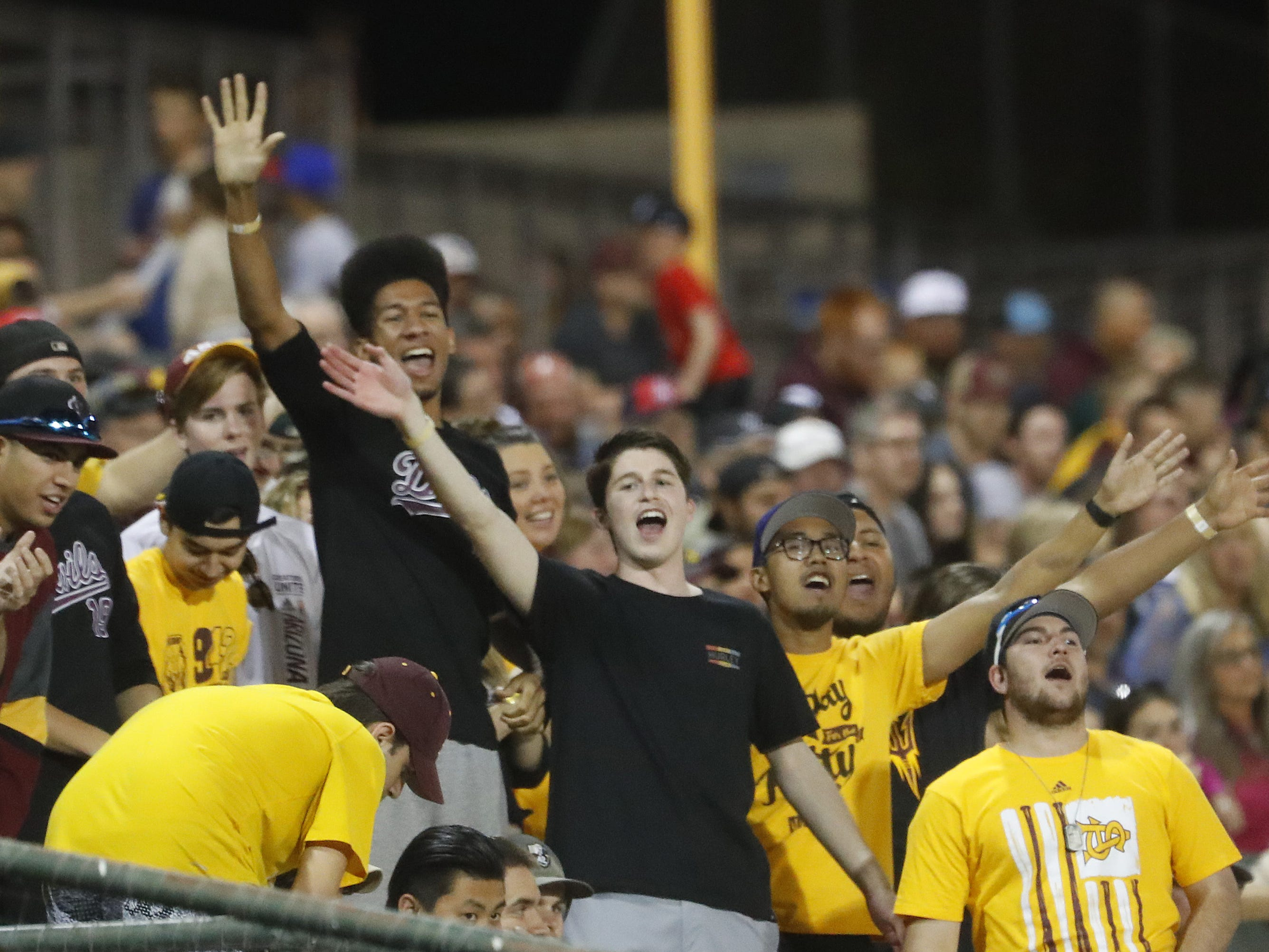 ASU fans wave bye to Arizona starting pitcher Quinn Flanagan (40) after Flanagan was pulled during the first inning at Phoenix Municipal Stadium in Phoenix, Ariz. on March 30, 2019.