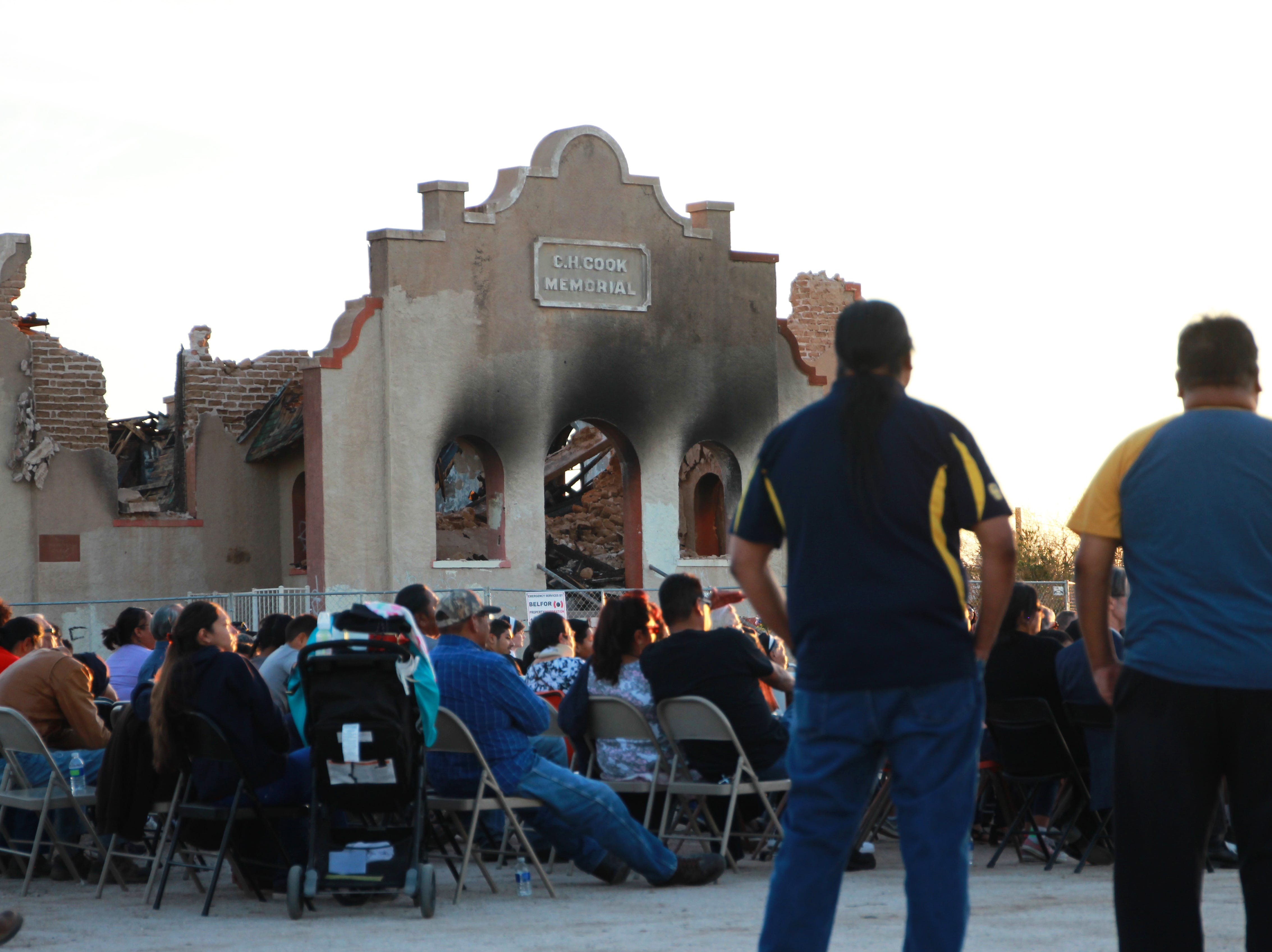The community gathered on Friday evening to share memories of the church and pray in front of the church.