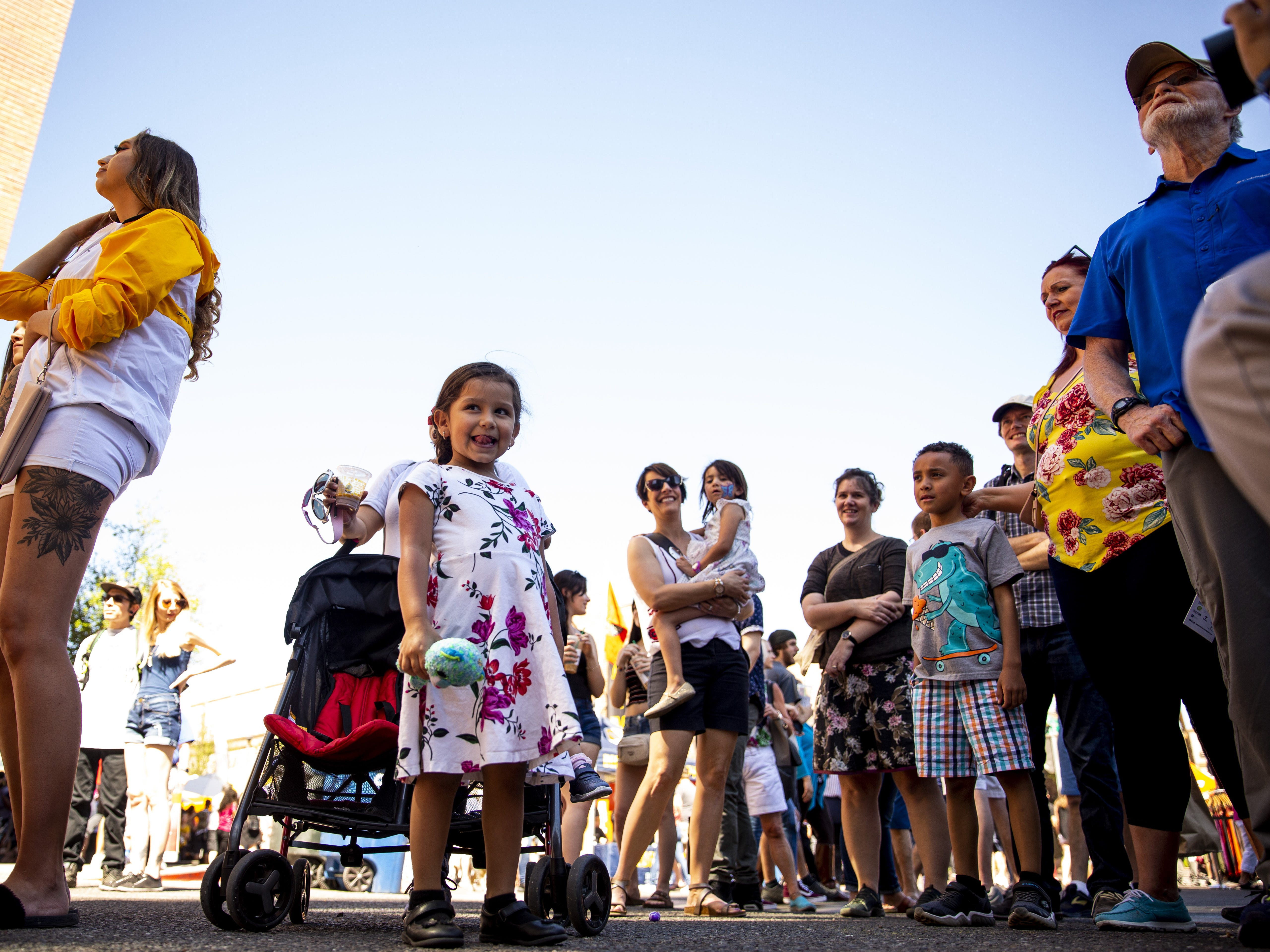 Ariana Pe–a, 3, watches a dance competition during the Spring Tempe Festival of the Arts on Saturday, March 30, 2019.