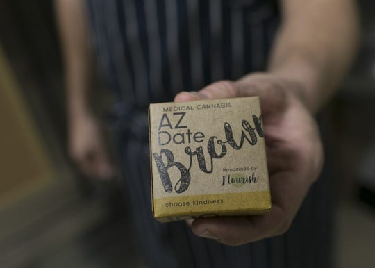 Cannabis cuisine chef Payton Curry shows off his company's award-winning cannabis-infused date brownie at the Harvest facility lab in Bellemont, Ariz. on Jan. 15, 2019. Curry's cannabis cuisine company Flourish specializes in quality ingredients and affordable prices for medicated food.