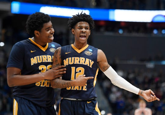 Murray State's Darnell Cowart (32) and Murray State's Ja Morant (12) during the first half of a first round men's college basketball game in the NCAA tournament, Thursday, March 21, 2019, in Hartford, Conn. (AP Photo/Jessica Hill)