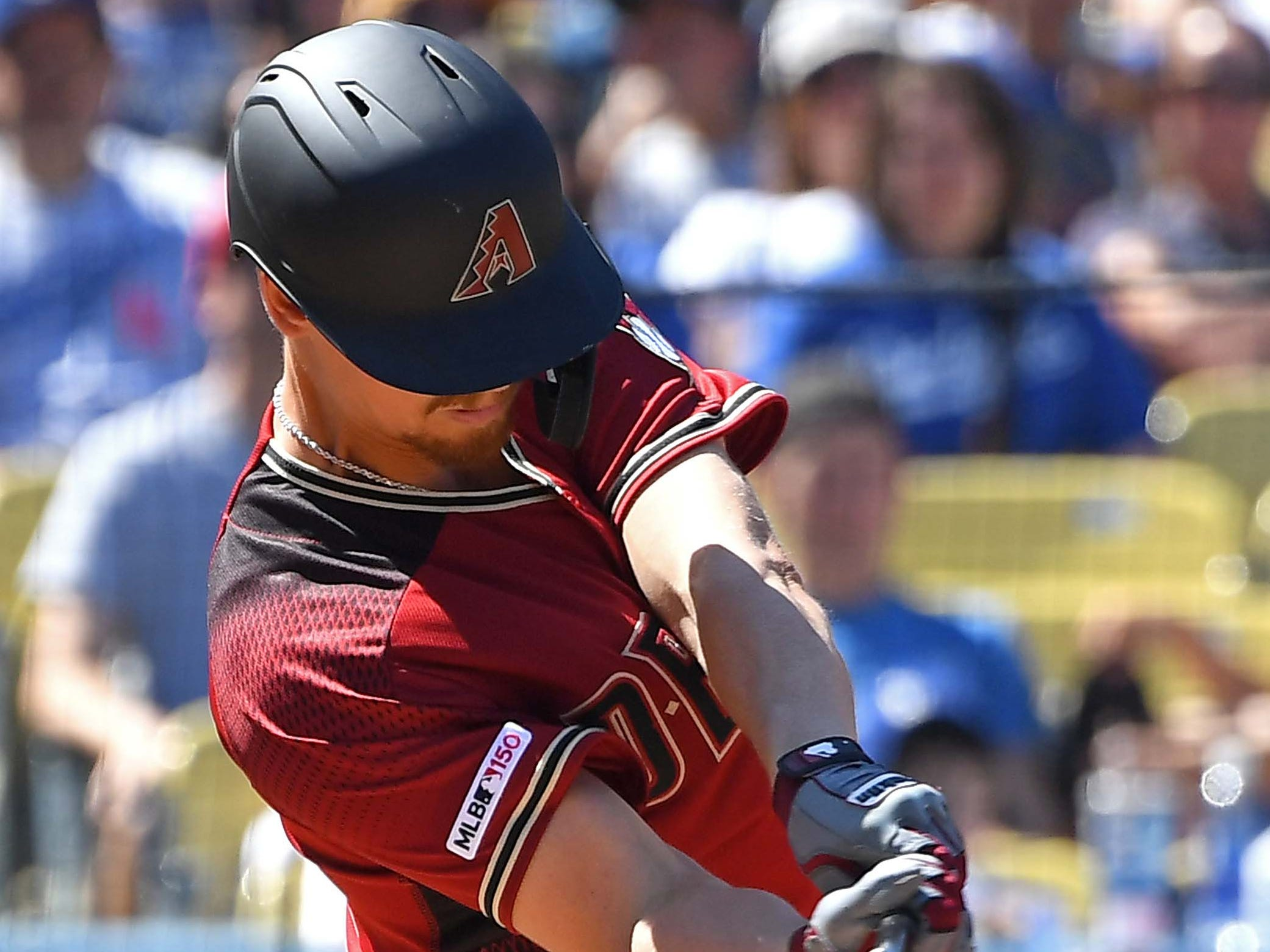 Mar 31, 2019; Los Angeles, CA, USA; Arizona Diamondbacks starting pitcher Luke Weaver (24) hits a solo home run in the fourth inning of the game against the Los Angeles Dodgers at Dodger Stadium.