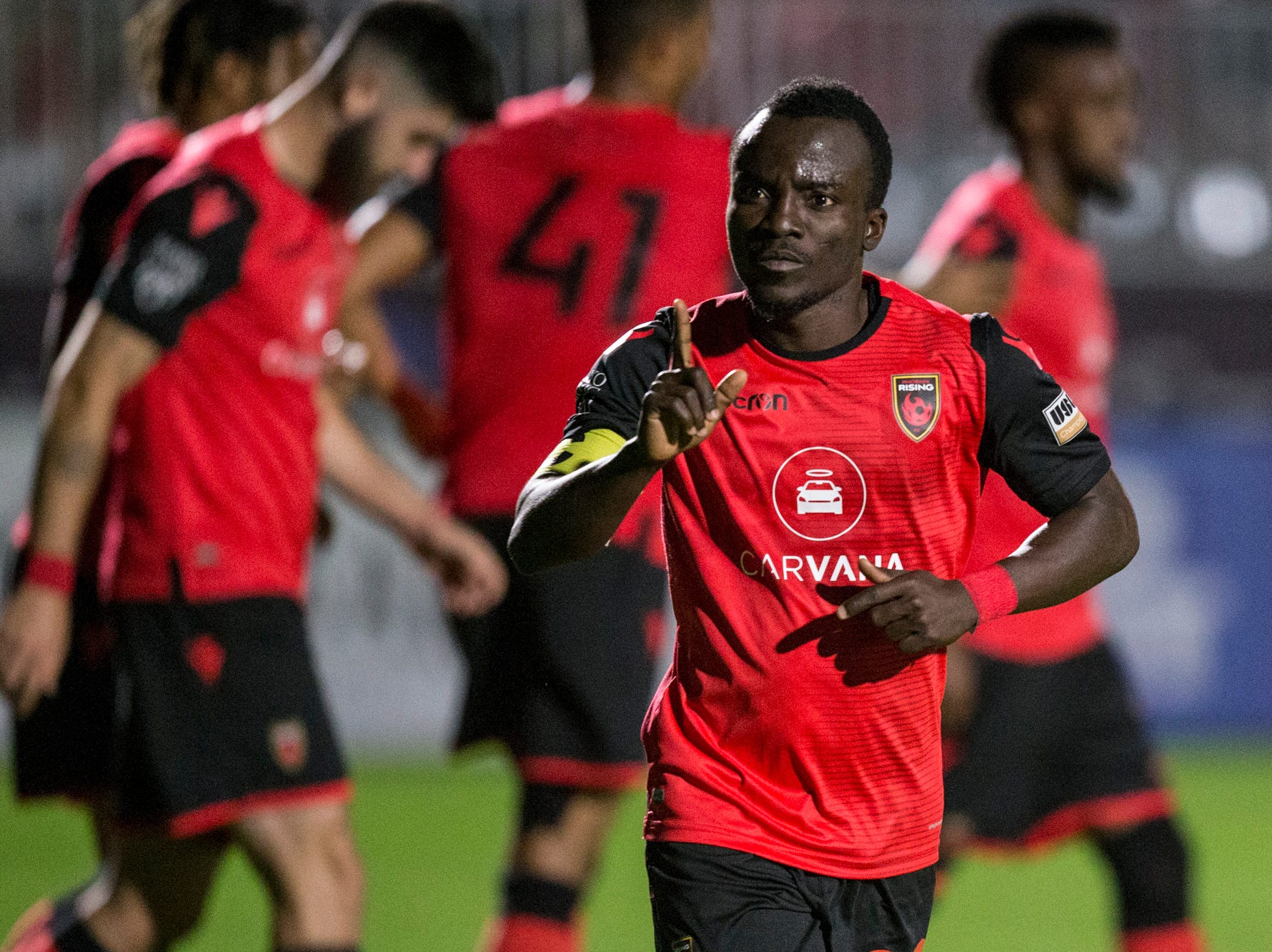 Phoenix Rising's Solomon Asante celebrates after a goal against Colorado Springs in the second half on Saturday, Mar. 30, 2019, at Casino Arizona Field in Tempe, Ariz.