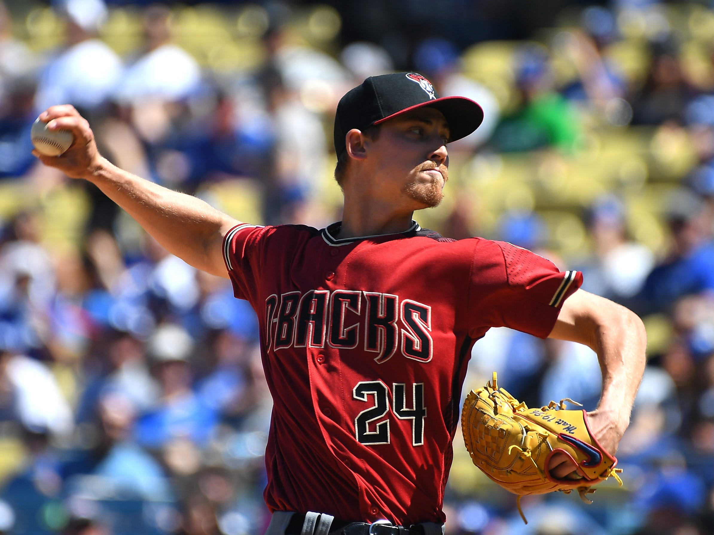 Mar 31, 2019; Los Angeles, CA, USA; Arizona Diamondbacks starting pitcher Luke Weaver (24) pitches in the second inning against the Los Angeles Dodgers at Dodger Stadium.