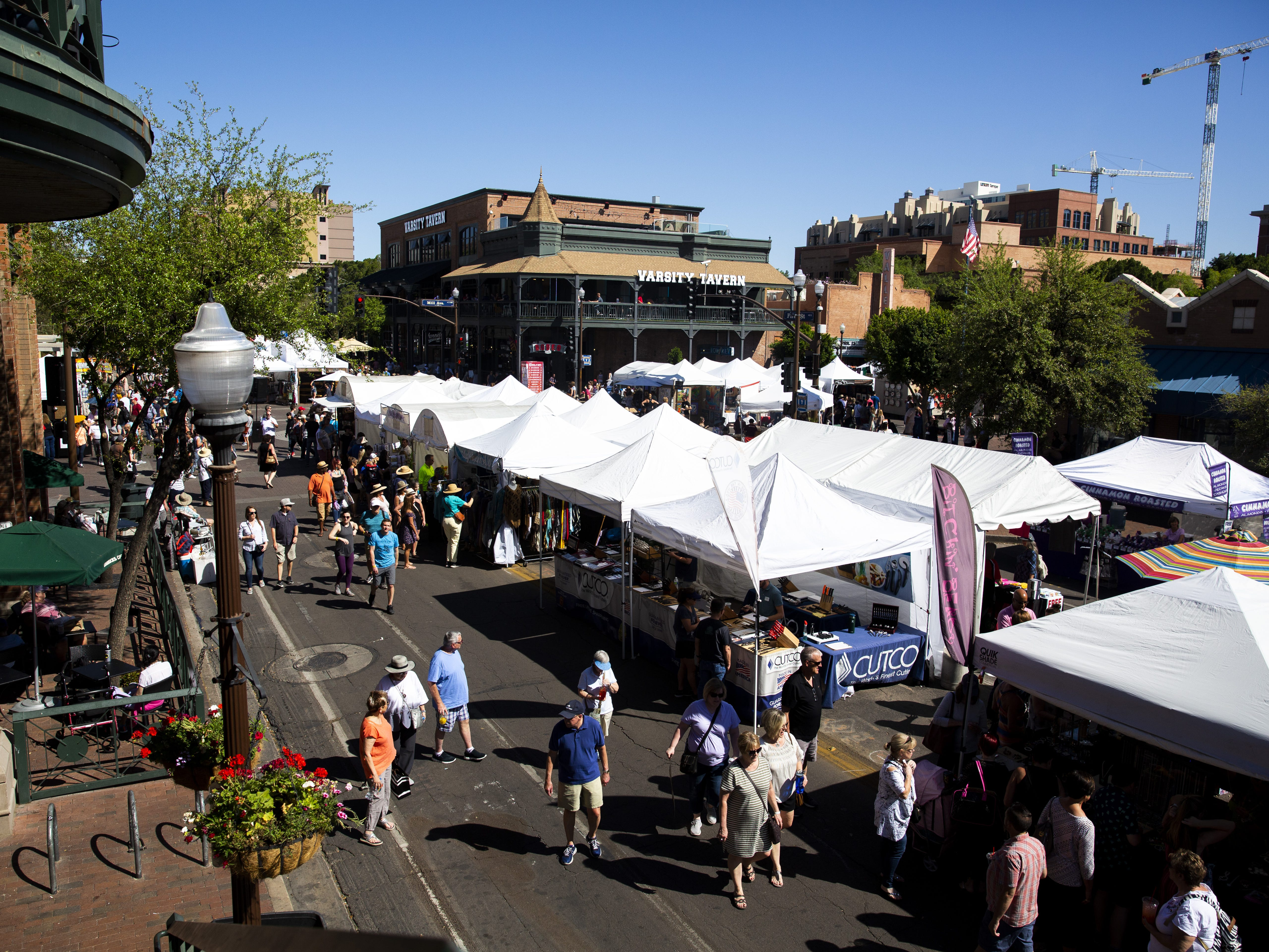 Hundreds of people wander around Mill Avenue and surrounding buildings during the Spring Tempe Festival of the Arts in downtown Tempe on March 30, 2019.