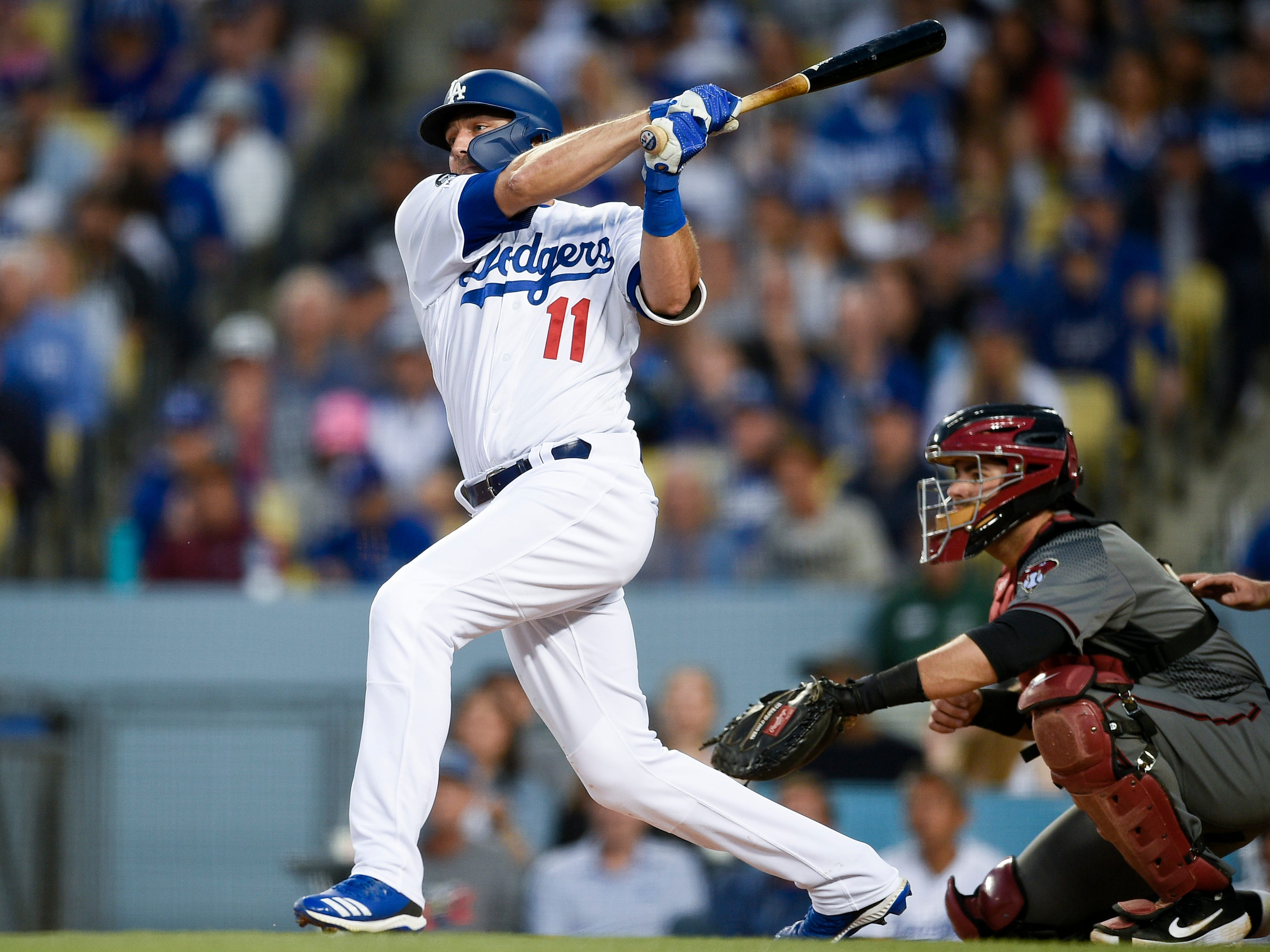 Mar 30, 2019; Los Angeles, CA, USA; Los Angeles Dodgers center fielder A.J. Pollock (11) follows through on a swing for an RBI single during the third inning against the Arizona Diamondbacks at Dodger Stadium. Mandatory Credit: Kelvin Kuo-USA TODAY Sports