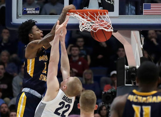 Murray State's Ja Morant dunks over Marquette's Joey Hauser during an NCAA Tournament game on March 21.