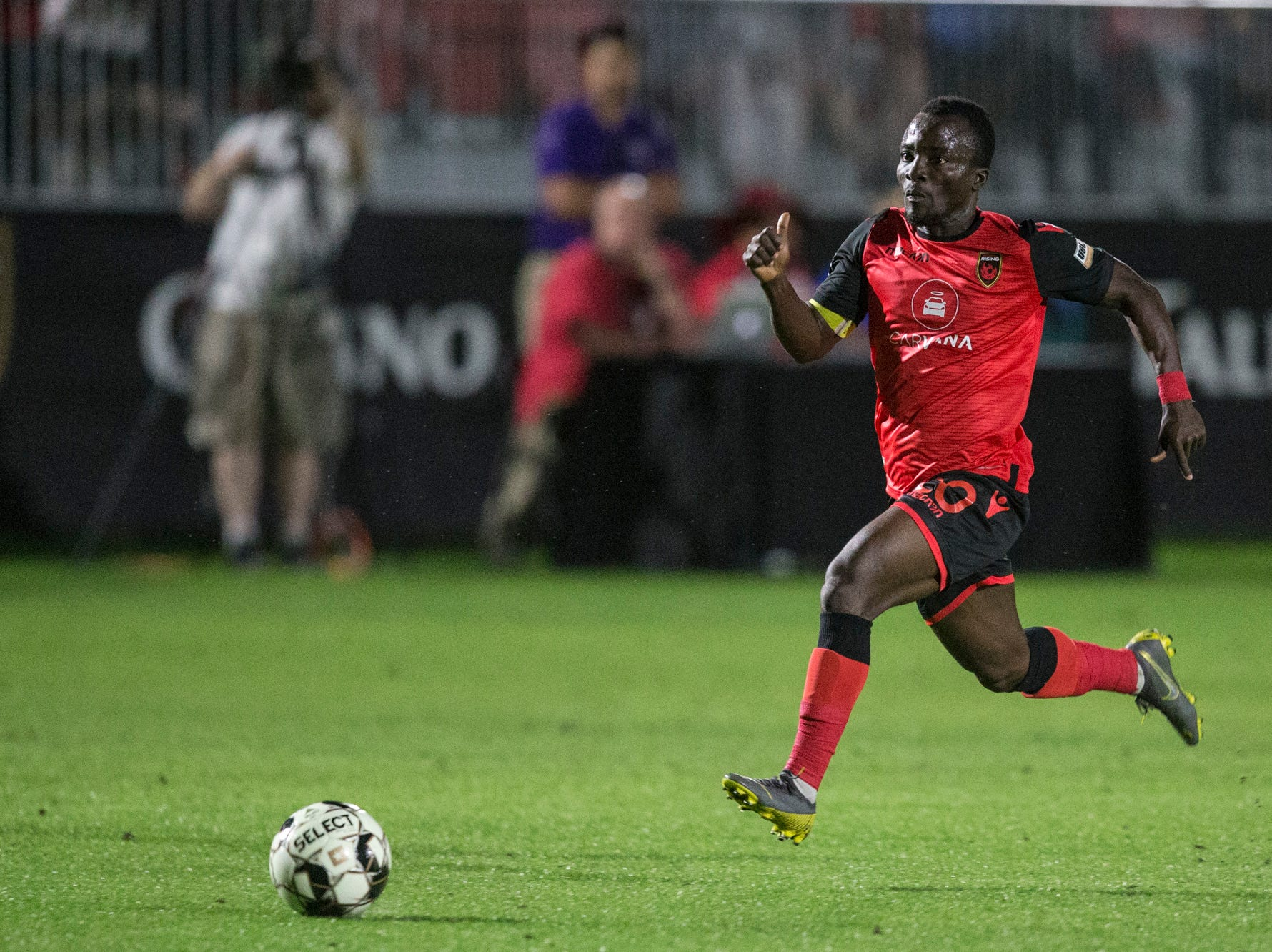 Phoenix Rising's Solomon Asante drives downfield against Colorado Springs in the first half on Saturday, Mar. 30, 2019, at Casino Arizona Field in Tempe, Ariz.