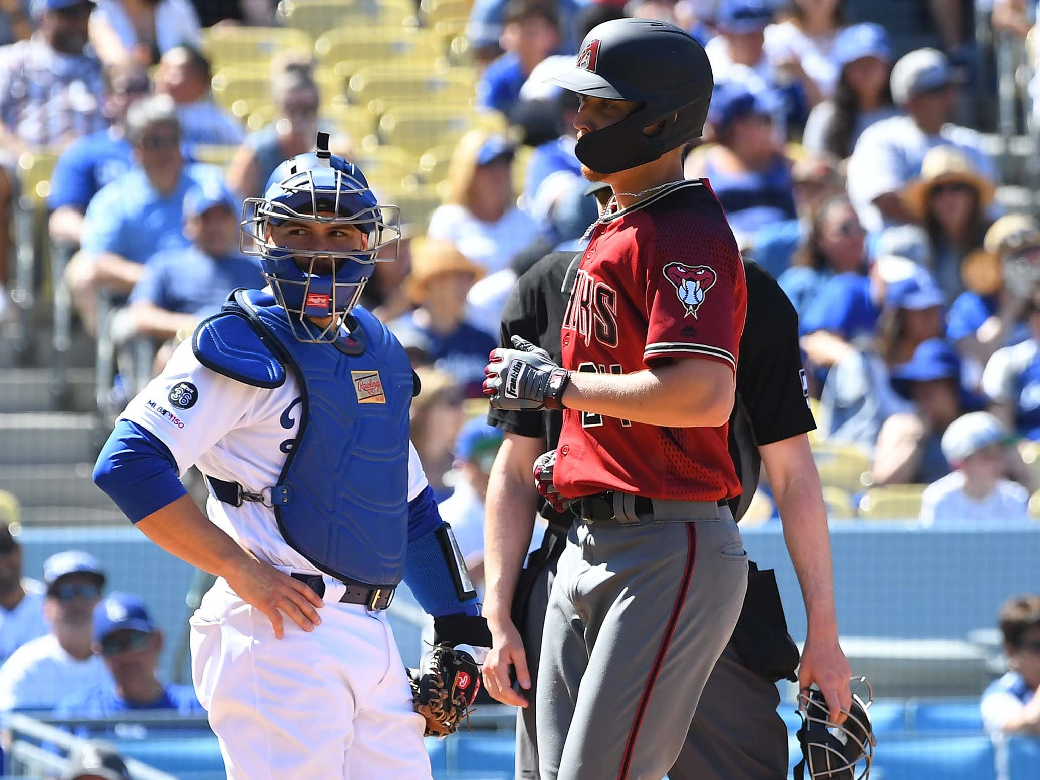 Mar 31, 2019; Los Angeles, CA, USA; Los Angeles Dodgers catcher Russell Martin (55) looks on as Arizona Diamondbacks starting pitcher Luke Weaver (24) crosses the plate after hitting a solo home run in the fourth inning of the game at Dodger Stadium.