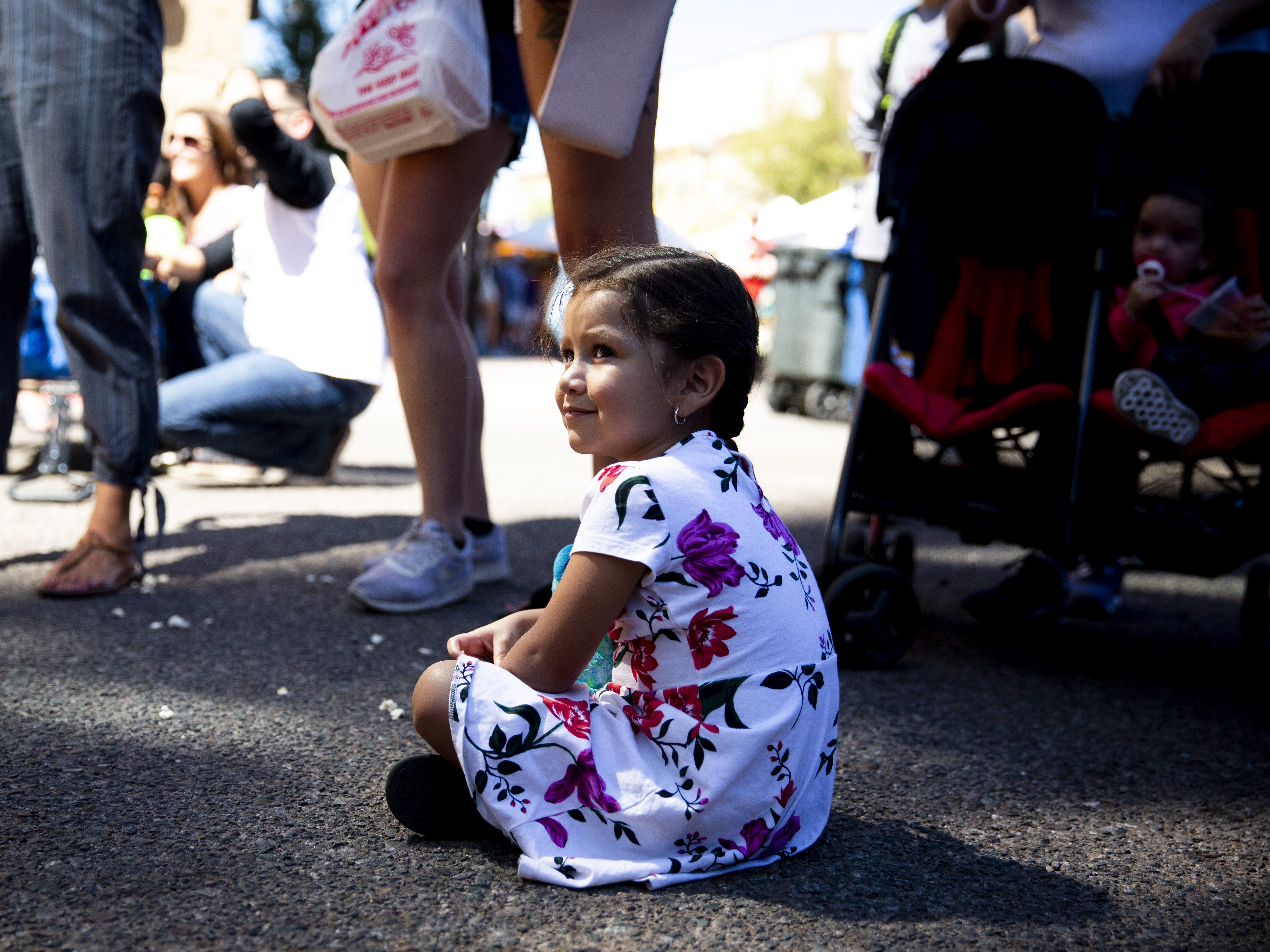 Ariana Peña, 3, watches a dance competition during the Spring Tempe Festival of the Arts on Saturday, March 30, 2019.