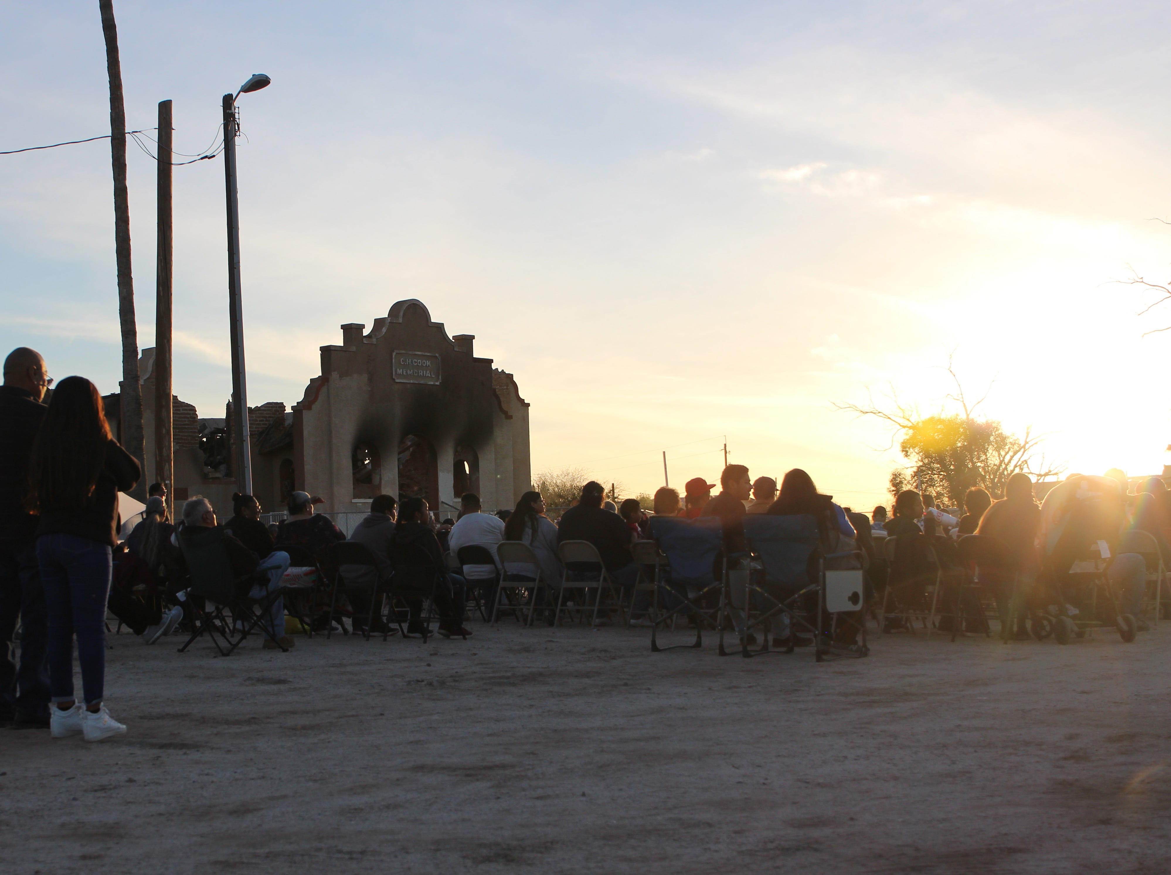 The sun sets over the crowd at the prayer vigil Friday evening.