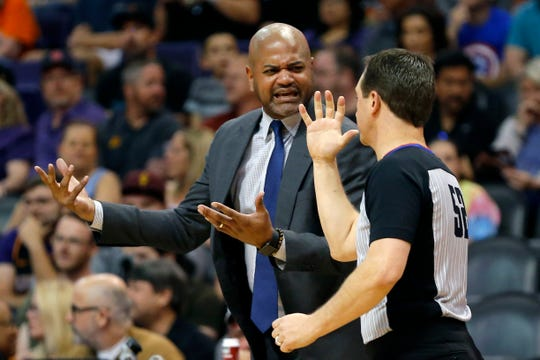 Memphis Grizzlies head coach J.B. Bickerstaff talks to NBA official Scott Twardoski in the first half during an NBA basketball game against the Phoenix Suns, Saturday, March 30, 2019, in Phoenix. (AP Photo/Rick Scuteri)