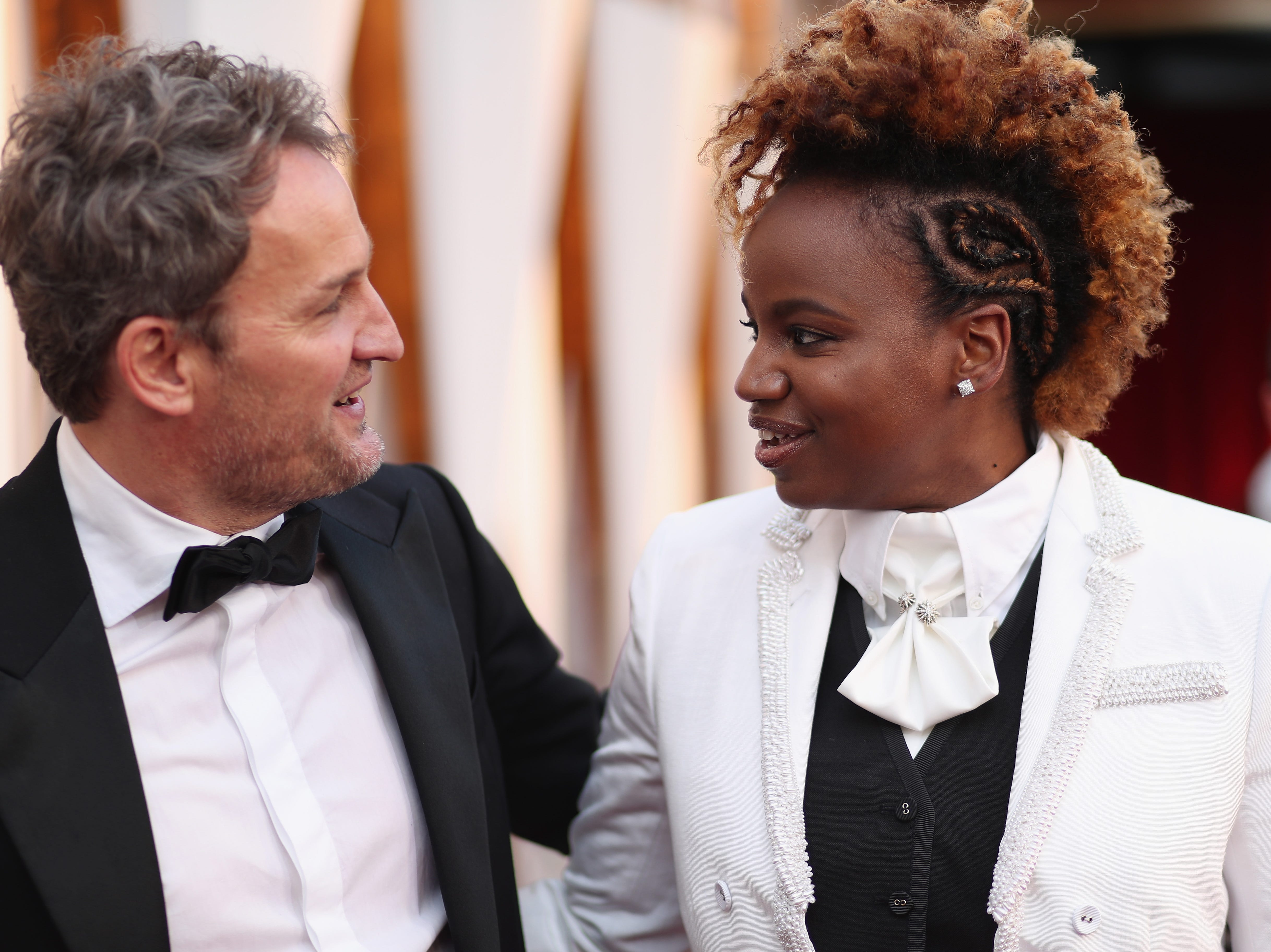 Jason Clarke and Dee Rees attend the Academy Awards on March 4, 2018, in Hollywood.