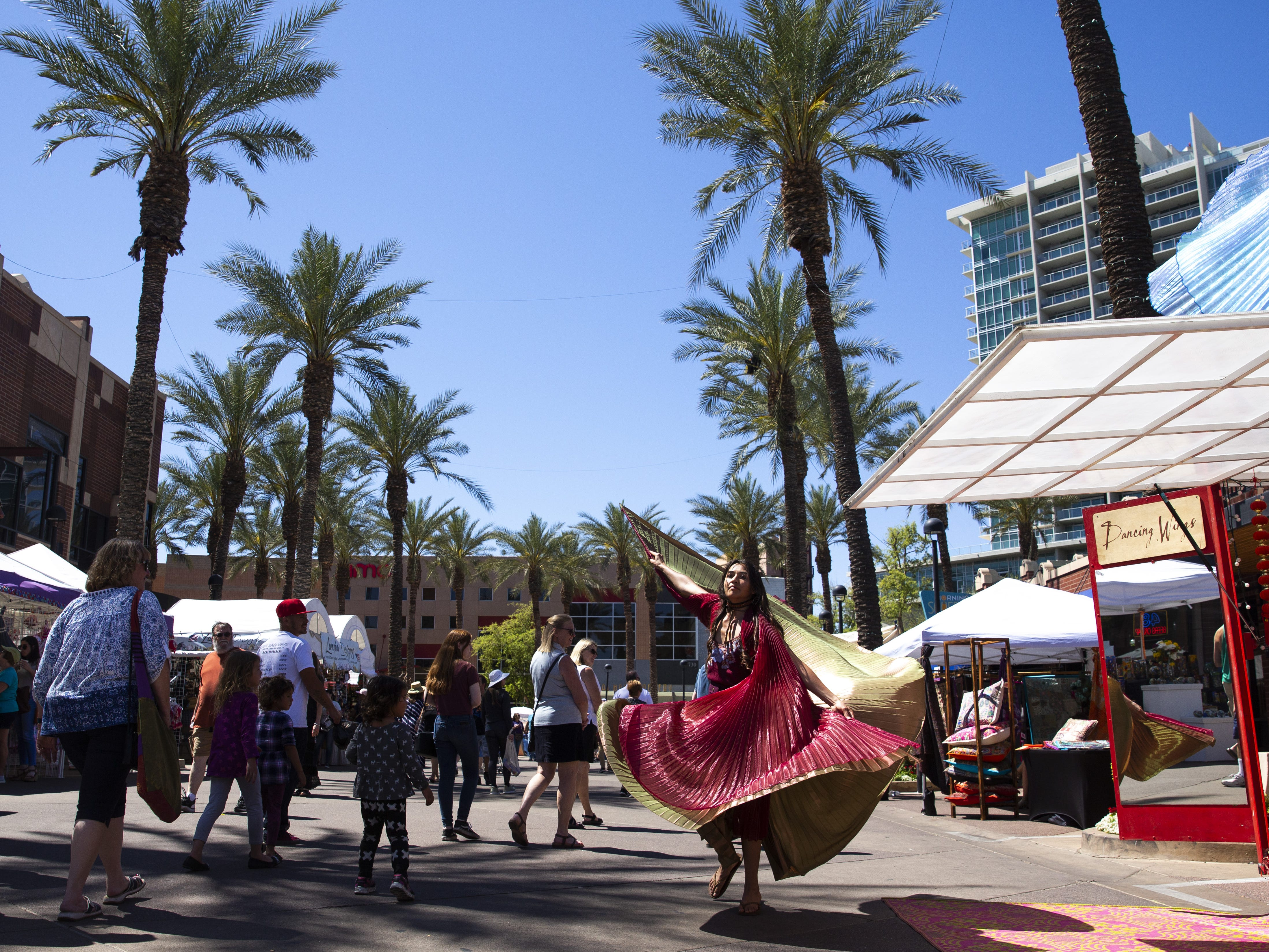Brii Faye models Dancing Wings at the Spring Tempe Festival of the Arts in downtown Tempe on March 30, 2019. Dancing Wings sells wings for both children and adults.