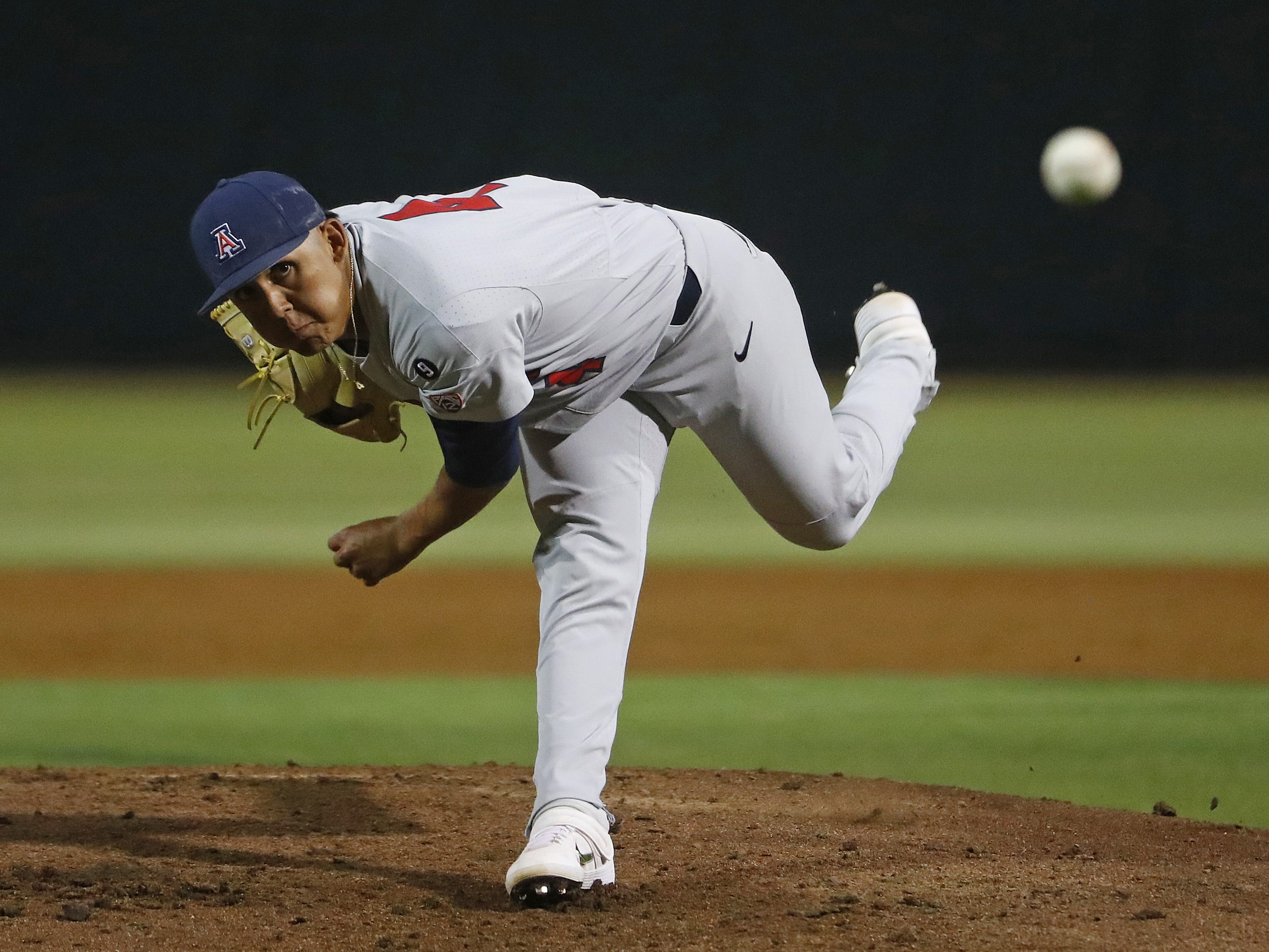 Arizona's Gil Luna (4) pitches against ASU during the first inning at Phoenix Municipal Stadium in Phoenix, Ariz. on March 30, 2019.