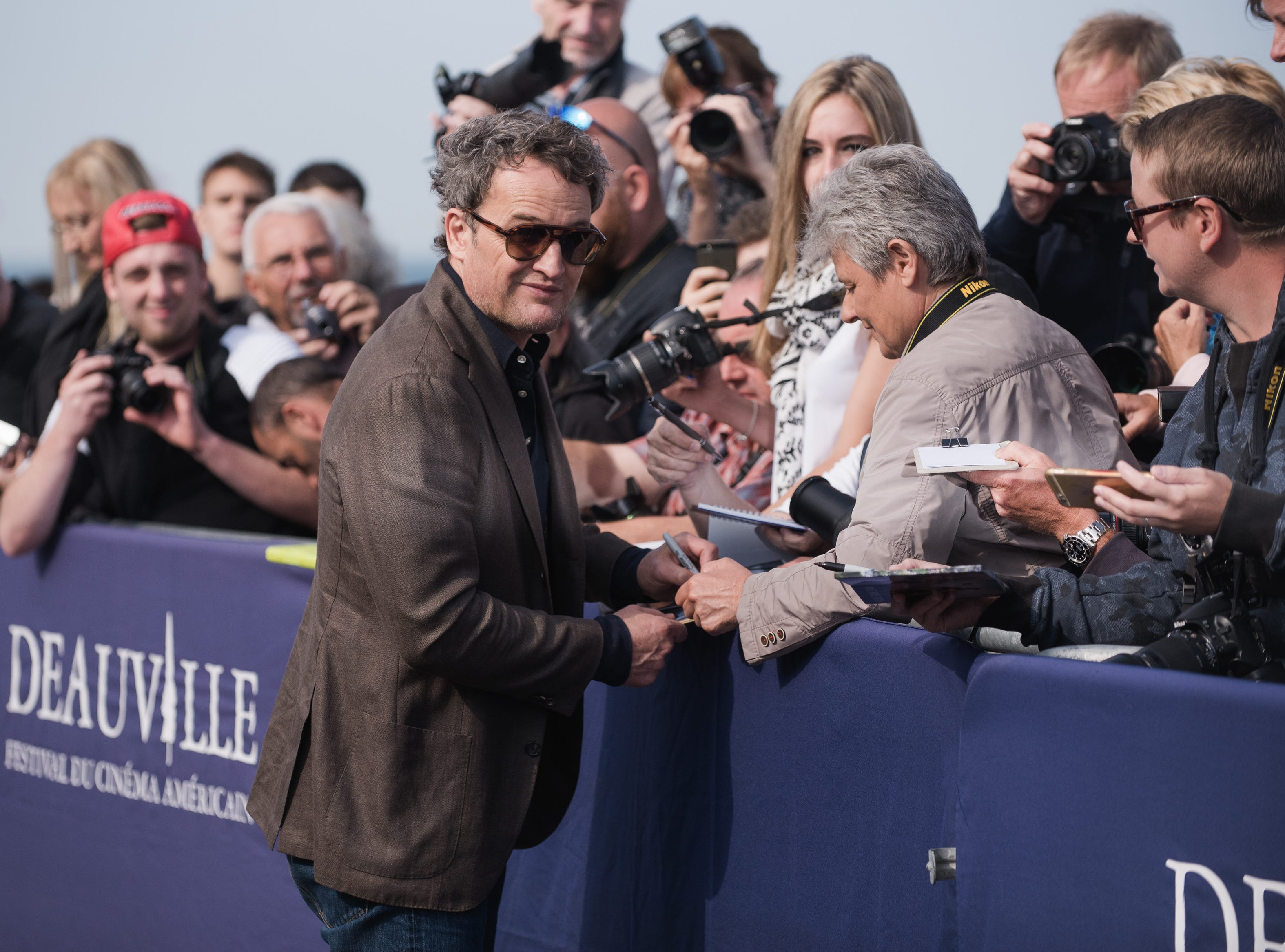 Jason Clarke signs autographs for fans during during the 44th Deauville US Film Festival  on Sept. 1, 2018, in Deauville, France.