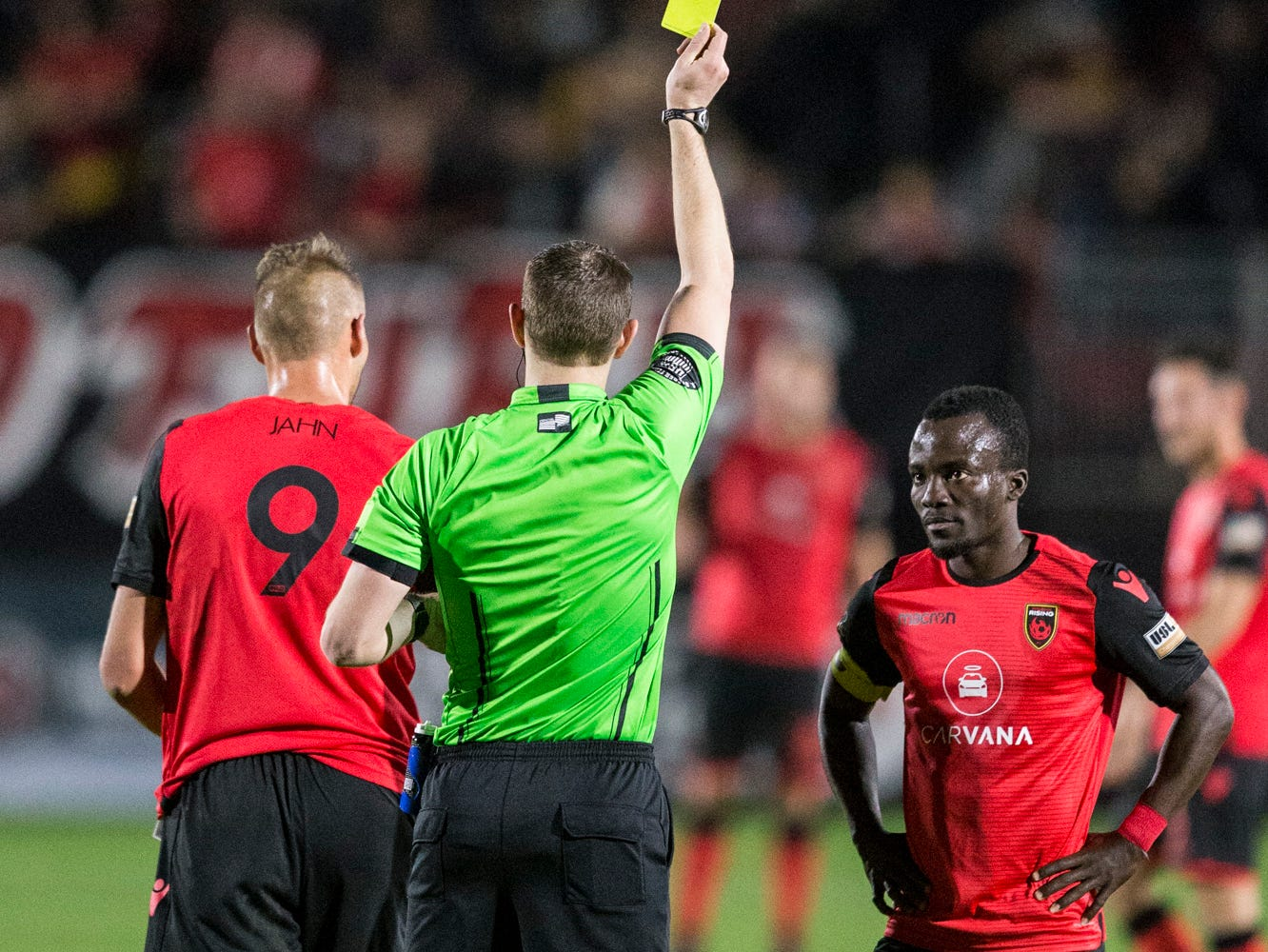 Phoenix Rising's Adam Jahn is given a yellow card against Colorado Springs in the first half on Saturday, Mar. 30, 2019, at Casino Arizona Field in Tempe, Ariz.