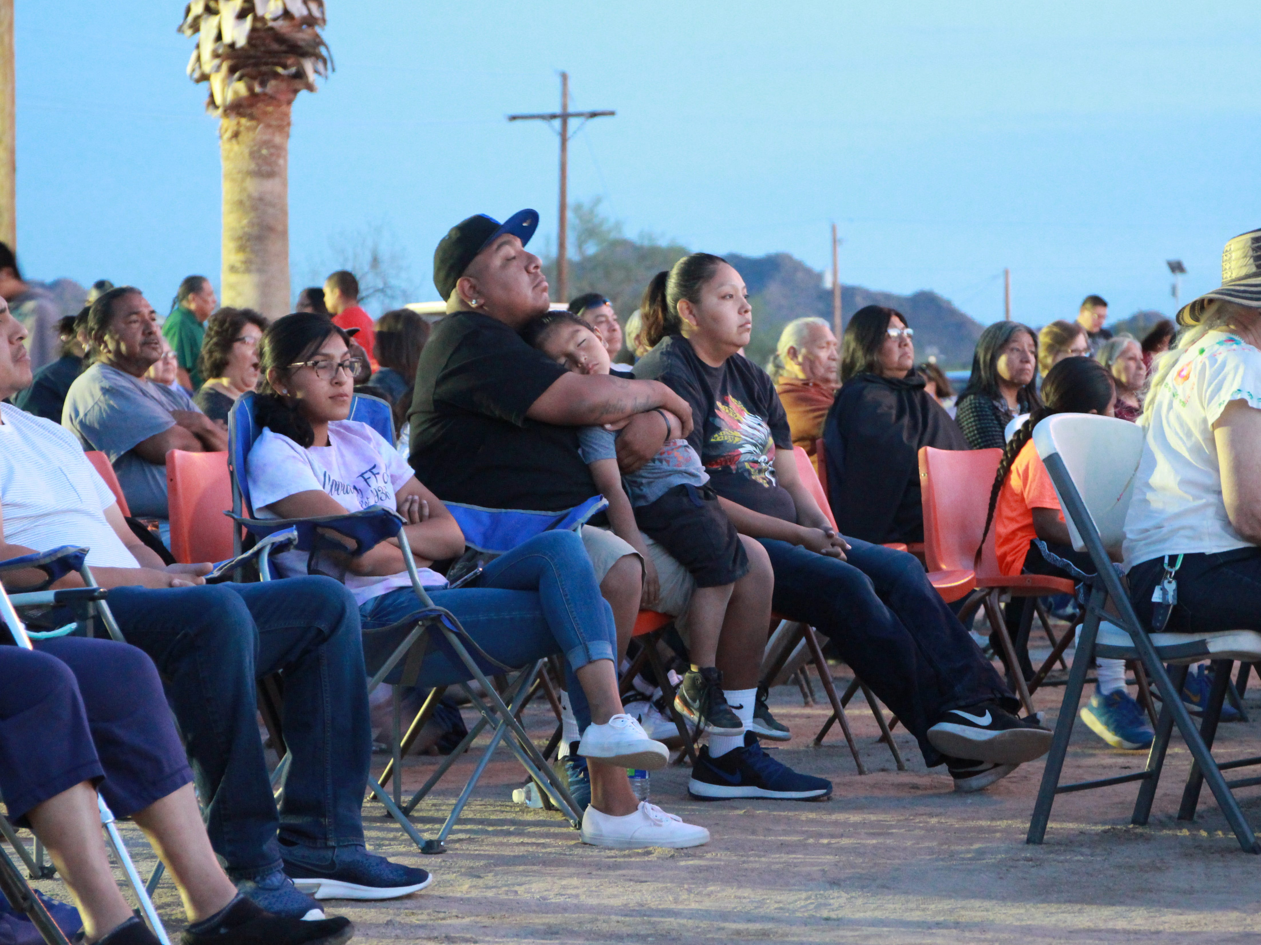 Members of the community listen to stories and memories of the old church.