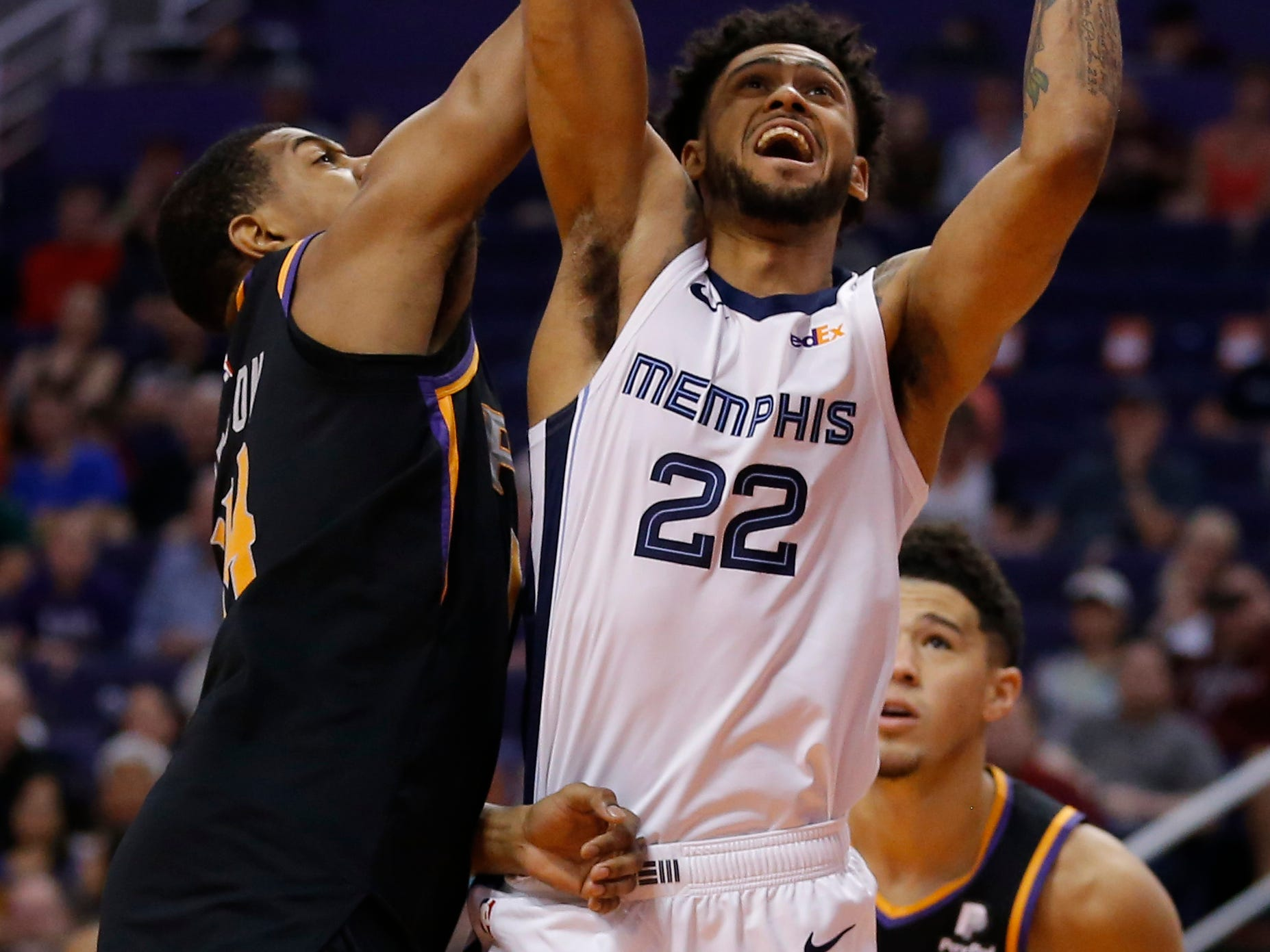 Memphis Grizzlies guard Tyler Dorsey, right, drives past Phoenix Suns guard De'Anthony Melton, left, in the first half during an NBA basketball game, Saturday, March 30, 2019, in Phoenix. (AP Photo/Rick Scuteri)