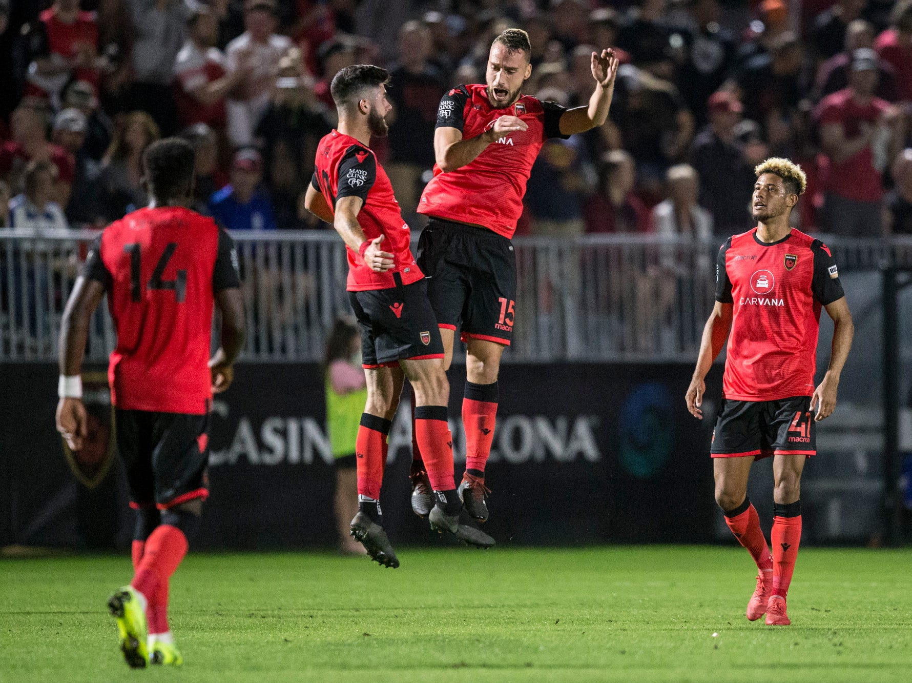 Phoenix Rising's Joseph Farrell (15) celebrates with Jon Bakero after scoring a goal against Colorado Springs in the first half on Saturday, Mar. 30, 2019, at Casino Arizona Field in Tempe, Ariz.