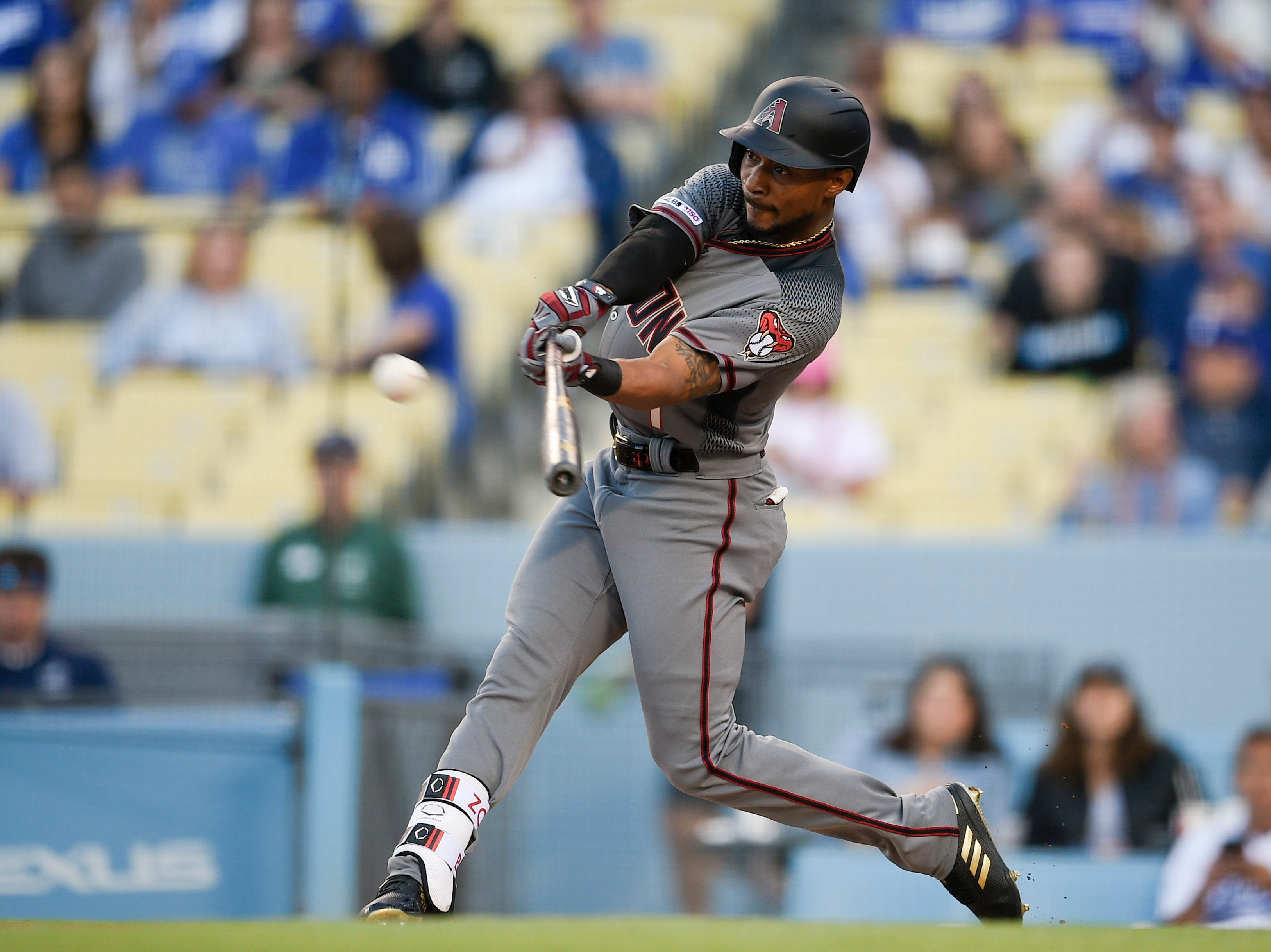 Mar 30, 2019; Los Angeles, CA, USA; Arizona Diamondbacks center fielder Jarrod Dyson (1) hits a solo home run during the first inning against the Los Angeles Dodgers at Dodger Stadium. Mandatory Credit: Kelvin Kuo-USA TODAY Sports