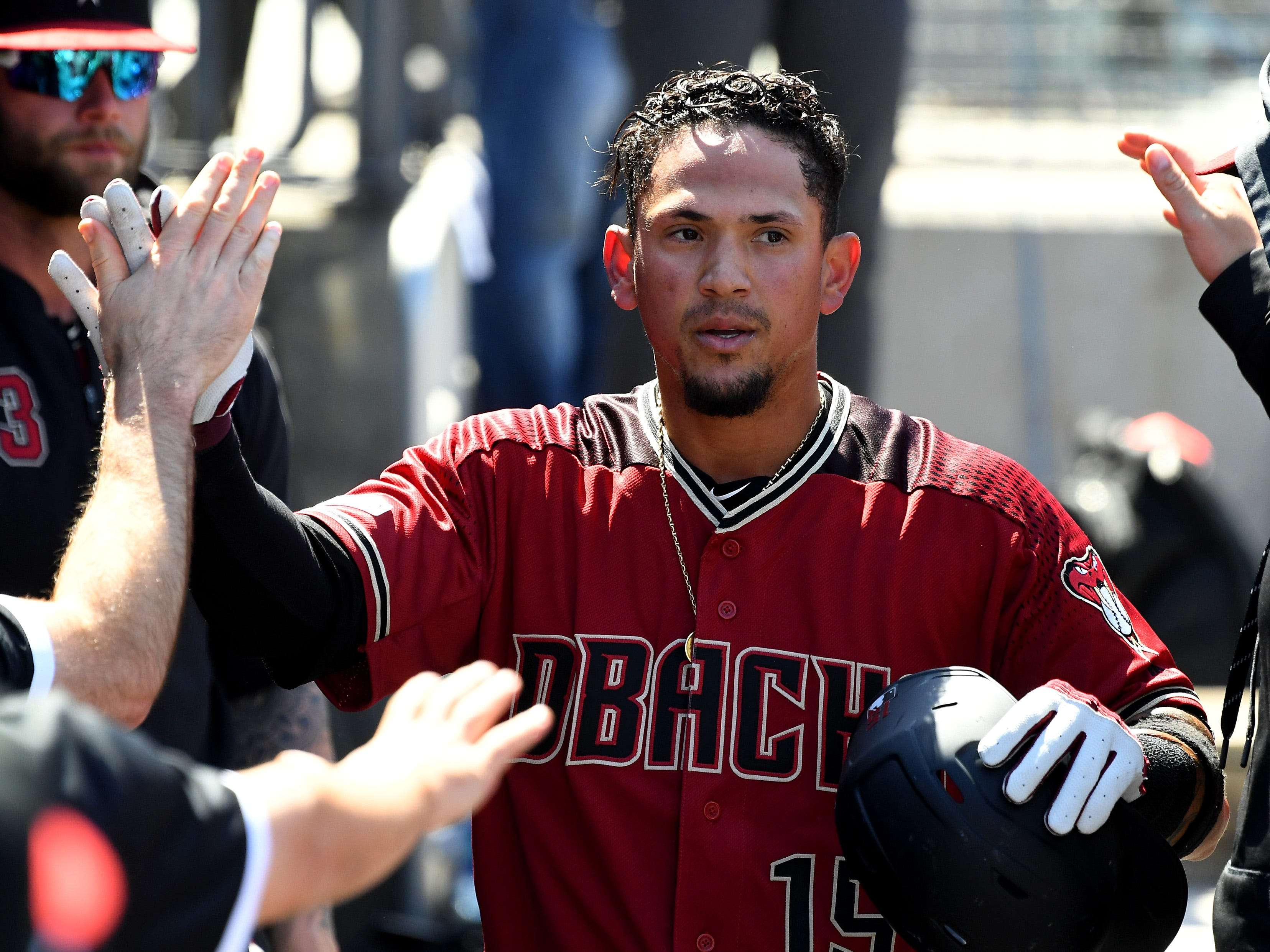 Mar 31, 2019; Los Angeles, CA, USA;    Arizona Diamondbacks second baseman Ildemaro Vargas (15) is greeted in the dugout after scoring a run against the Los Angeles Dodgers in the fourth inning at Dodger Stadium.