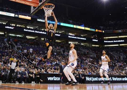 Mar 30, 2019; Phoenix, AZ, USA; Phoenix Suns guard Devin Booker (1) puts up a layup against the Memphis Grizzlies during the first half at Talking Stick Resort Arena. Mandatory Credit: Joe Camporeale-USA TODAY Sports