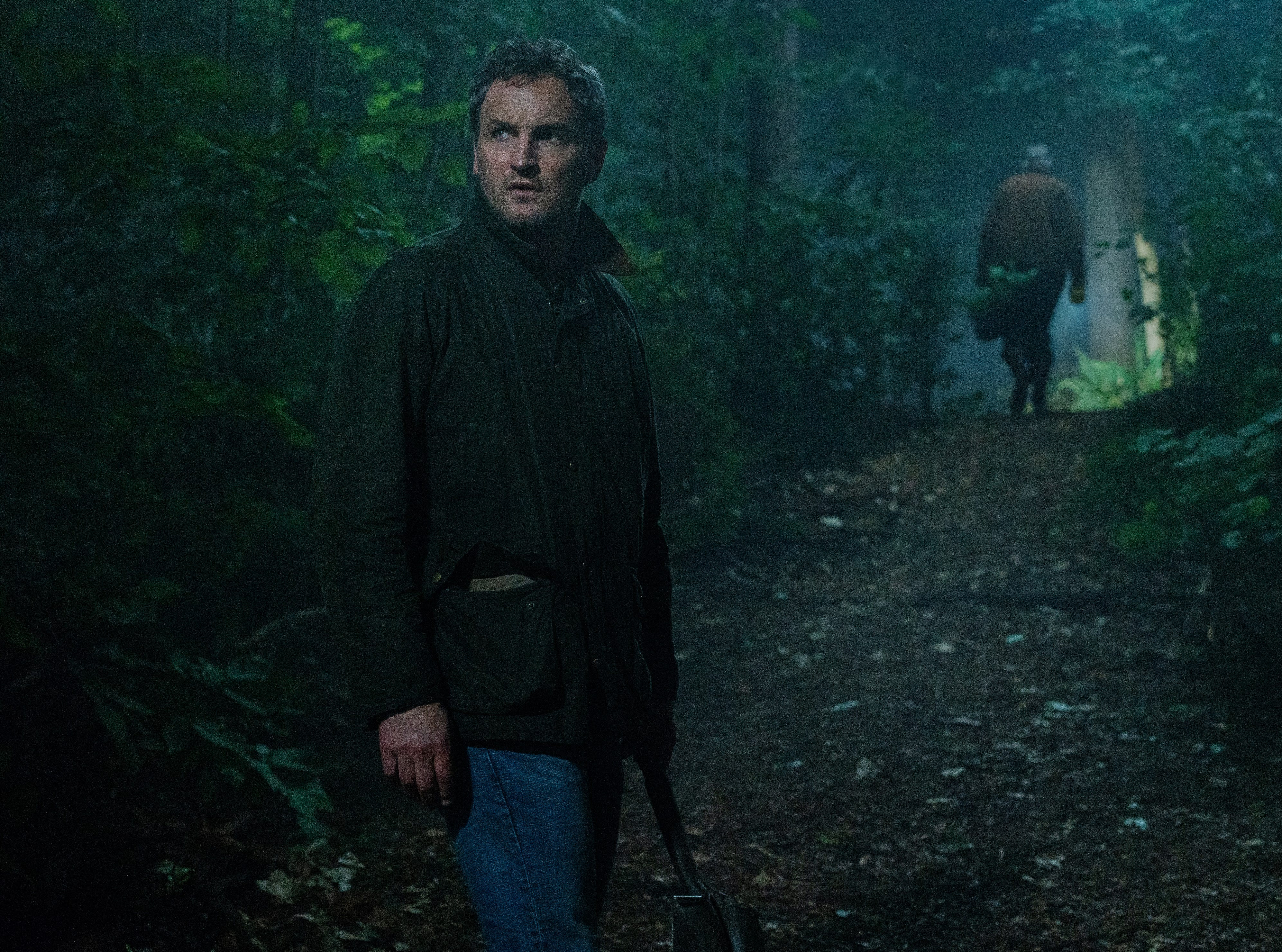 "Louis (Jason Clarke) explores some mysterious grounds in ""Pet Sematary."""