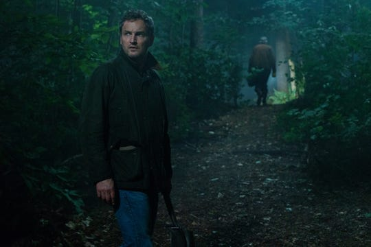 """Louis (Jason Clarke) explores some mysterious grounds in """"Pet Sematary."""""""