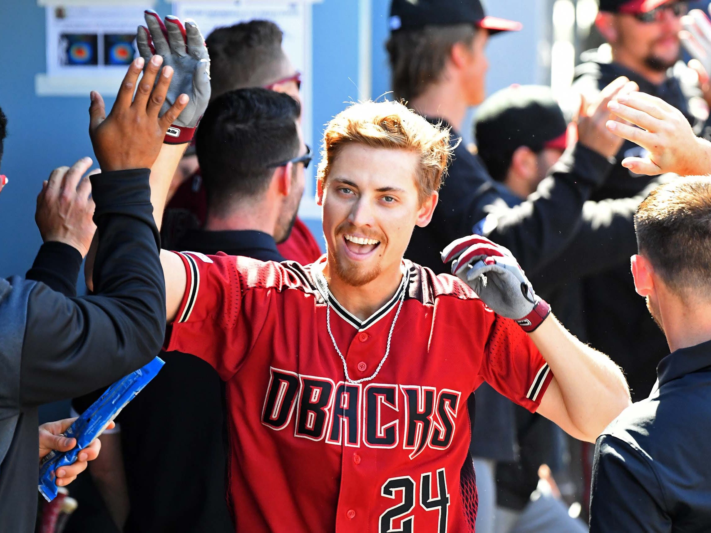 Mar 31, 2019; Los Angeles, CA, USA; Arizona Diamondbacks starting pitcher Luke Weaver (24) is greeted in the dugout after hitting a solo home run in the fourth inning of the game at Dodger Stadium.