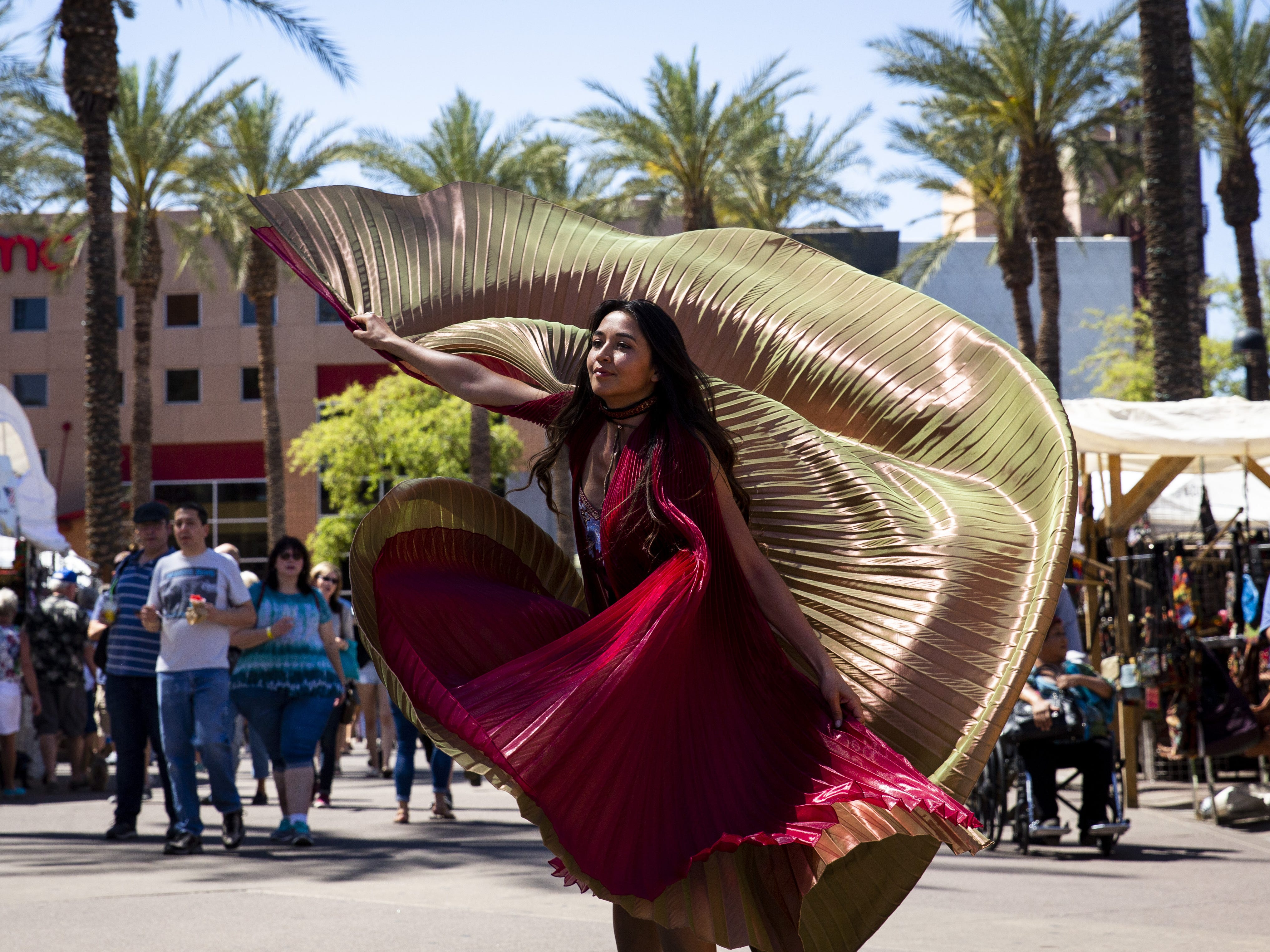 Brii Faye demonstrates how to use Dancing Wings at the Spring Tempe Festival of the Arts Tempe on Saturday, March 30, 2019.