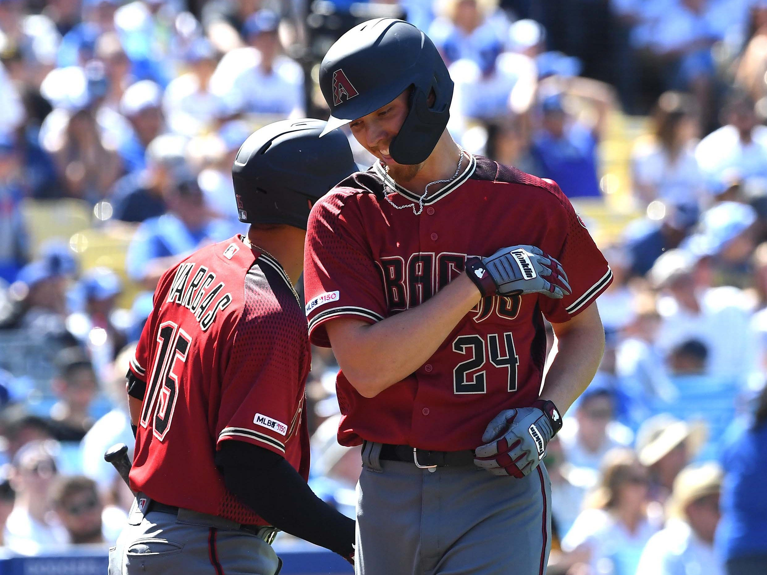 Mar 31, 2019; Los Angeles, CA, USA; Arizona Diamondbacks starting pitcher Luke Weaver (24) is greeted by Arizona Diamondbacks second baseman Ildemaro Vargas (15) after he crosses the plate after hitting a solo home run in the fourth inning of the game at Dodger Stadium.