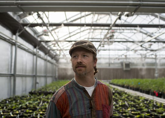 Cannabis cuisine chef Payton Curry walks through the Harvest grow operation in Camp Verde, Ariz. on Feb. 7, 2018. Harvest is one of the largest cannabis companies in the United States and a partner of Curry's cannabis cuisine company Flourish.