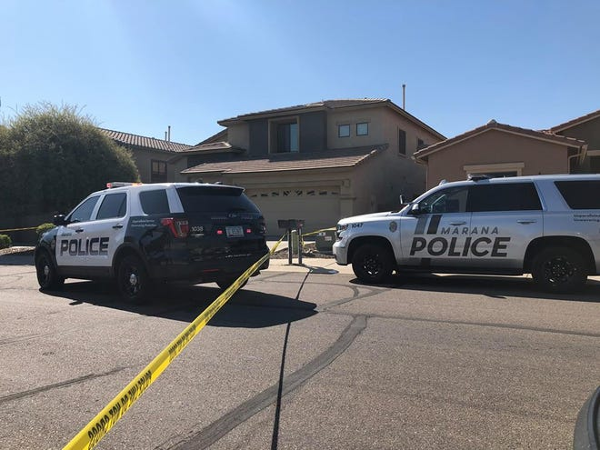 Police investigate an officer-involved shooting at a home near 7400 West Crimson Ridge Road on the morning of March 31, 2019.