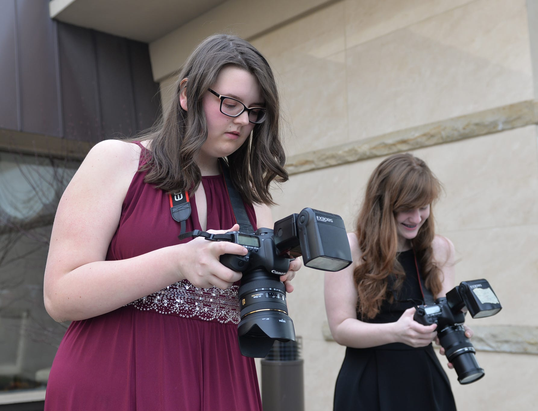 Student photographers check their cameras at the Elco High School prom, held at Eden Resorts on Saturday, March 30, 2019.