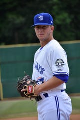 Mike Pascoe, an Arlington High School grad and Toronto Blue Jays prospect, looks in for the sign while pitching for the Bluefield Blue Jays last August.