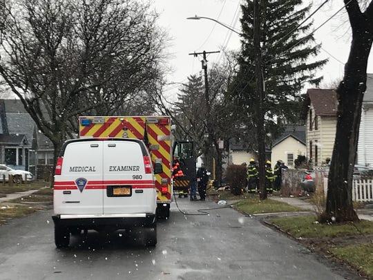 Medical Examiner on scene of fatal house fire on Langham St. Rochester Sunday Mar. 31, 2019.