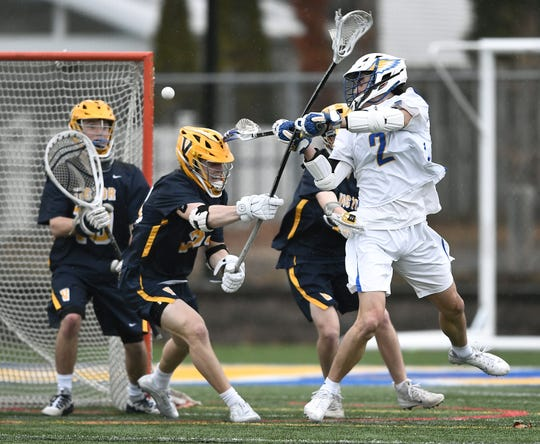 Irondequoit's Jack Brennan, right, scores the Eagles' fifth goal over Victor's Sutton Boland on Saturday. Both are players to watch this season.