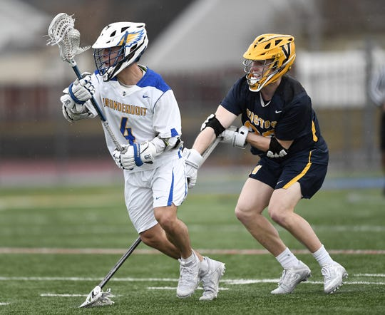 Irondequoit's Keegan Vankerkhove, left, avoids pressure from Victor's Sutton Boland during a game at Irondequoit High School, Saturday, March 29, 2019. Victor beat Irondequoit 14-9.