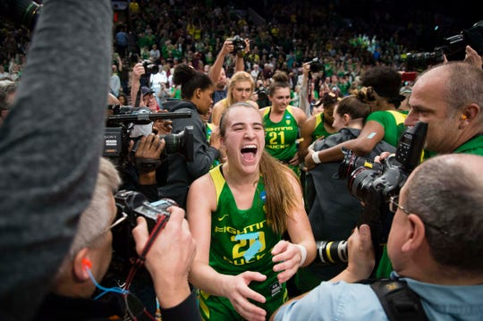 Oregon Ducks guard Sabrina Ionescu (20) celebrates after a game against the Mississippi State Bulldogs in the championship game of the Portland regional in the women's 2019 NCAA Tournament at Moda Center. The Oregon Ducks beat the Mississippi State Bulldogs 88-84.