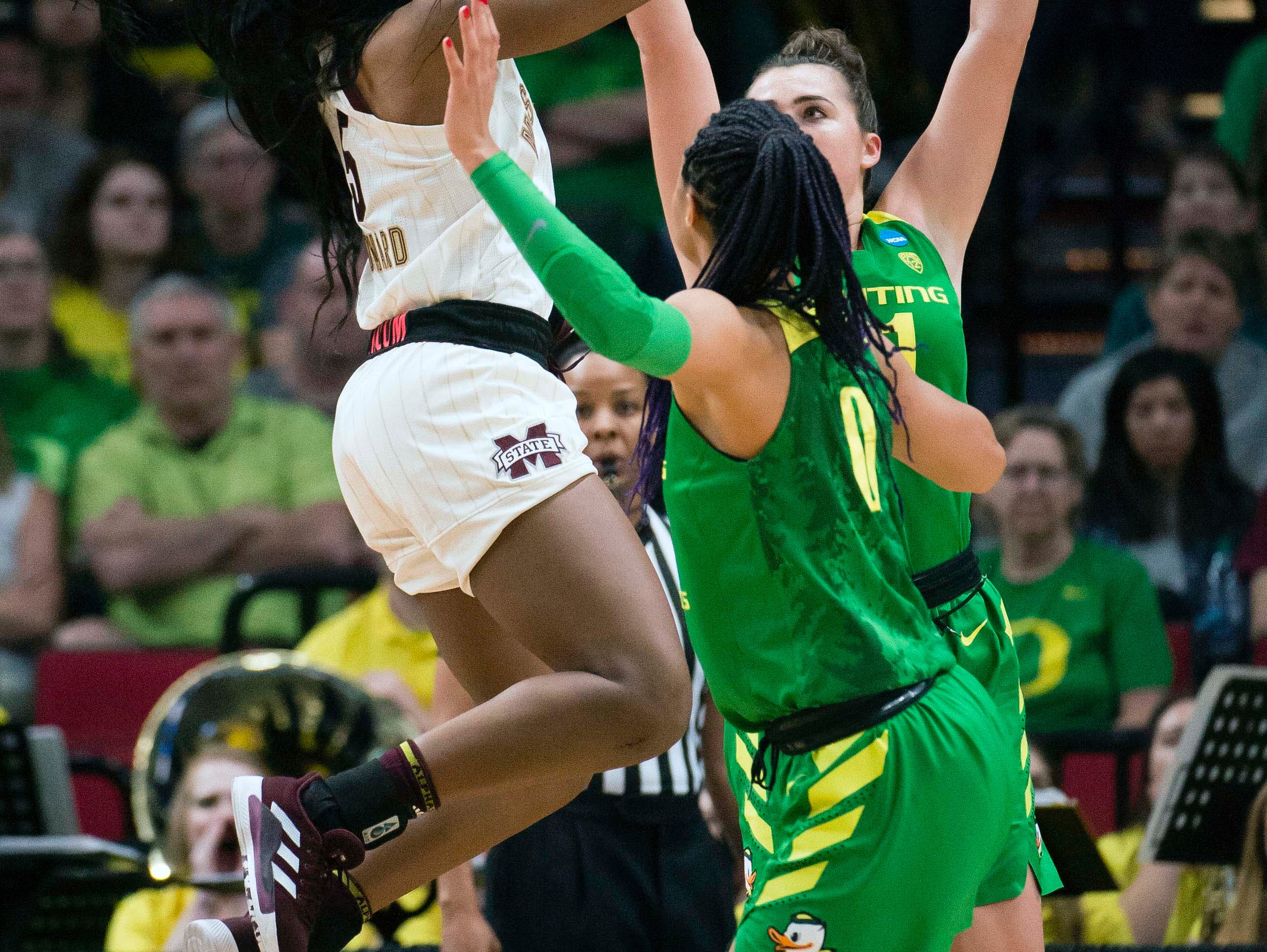Mississippi State Bulldogs forward Anriel Howard (5) scores a basket against Oregon Ducks forward Satou Sabally (0) during the first half in the championship game of the Portland regional in the women's 2019 NCAA Tournament at Moda Center.