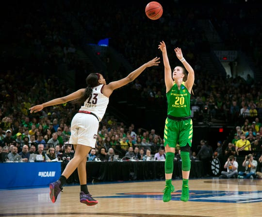 Oregon Ducks guard Sabrina Ionescu (20) scores a three point basket during the first half against Mississippi State Bulldogs guard Bre'Amber Scott (23) in the championship game of the Portland regional in the women's 2019 NCAA Tournament at Moda Center.