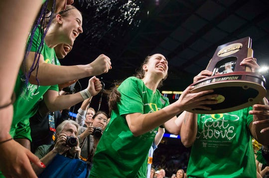Oregon Ducks guard Maite Cazorla (5) celebrates with teammates after a game against the Mississippi State Bulldogs in the championship game of the Portland regional in the women's 2019 NCAA Tournament at Moda Center. The Oregon Ducks beat the Mississippi State Bulldogs 88-84.