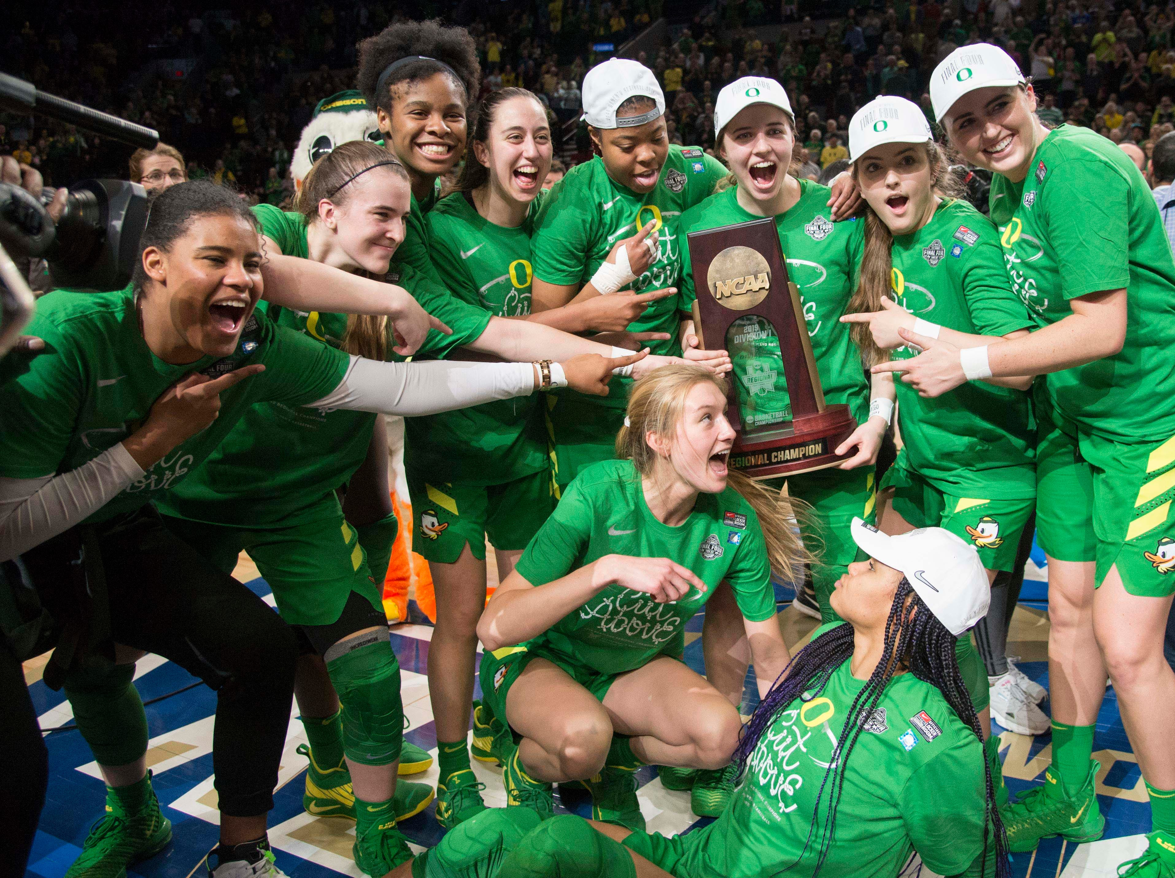 The Oregon Ducks women's basketball team celebrate after a game against the Mississippi State Bulldogs in the championship game of the Portland regional in the women's 2019 NCAA Tournament at Moda Center. The Oregon Ducks beat the Mississippi State Bulldogs 88-84.