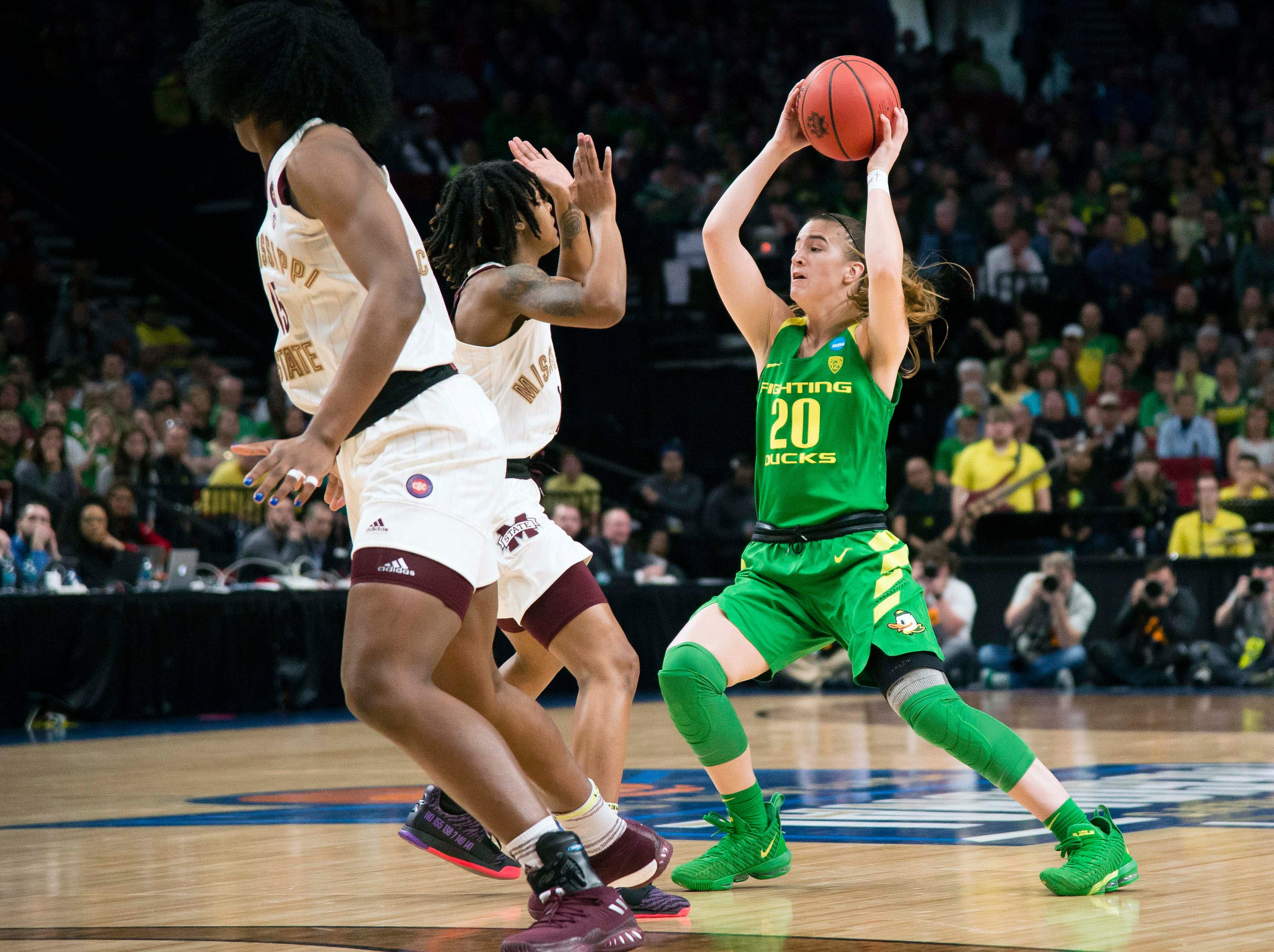 Oregon Ducks guard Sabrina Ionescu (20) looks to pass the ball against during the first half against Mississippi State Bulldogs in the championship game of the Portland regional in the women's 2019 NCAA Tournament at Moda Center.