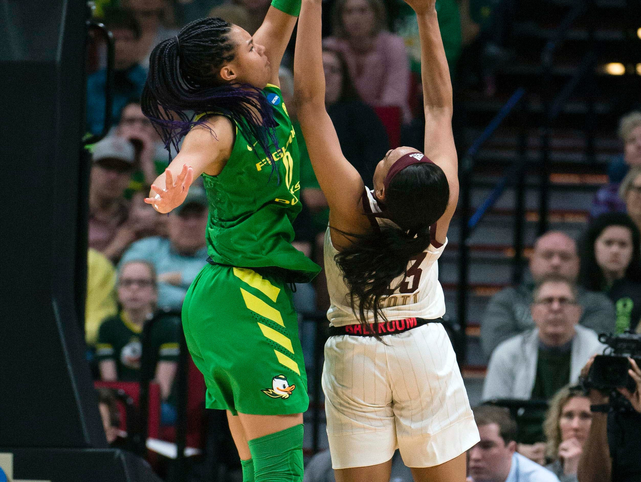 Oregon Ducks forward Satou Sabally (0) guards Mississippi State Bulldogs guard Bre'Amber Scott (23) during the first half in the championship game of the Portland regional in the women's 2019 NCAA Tournament at Moda Center.