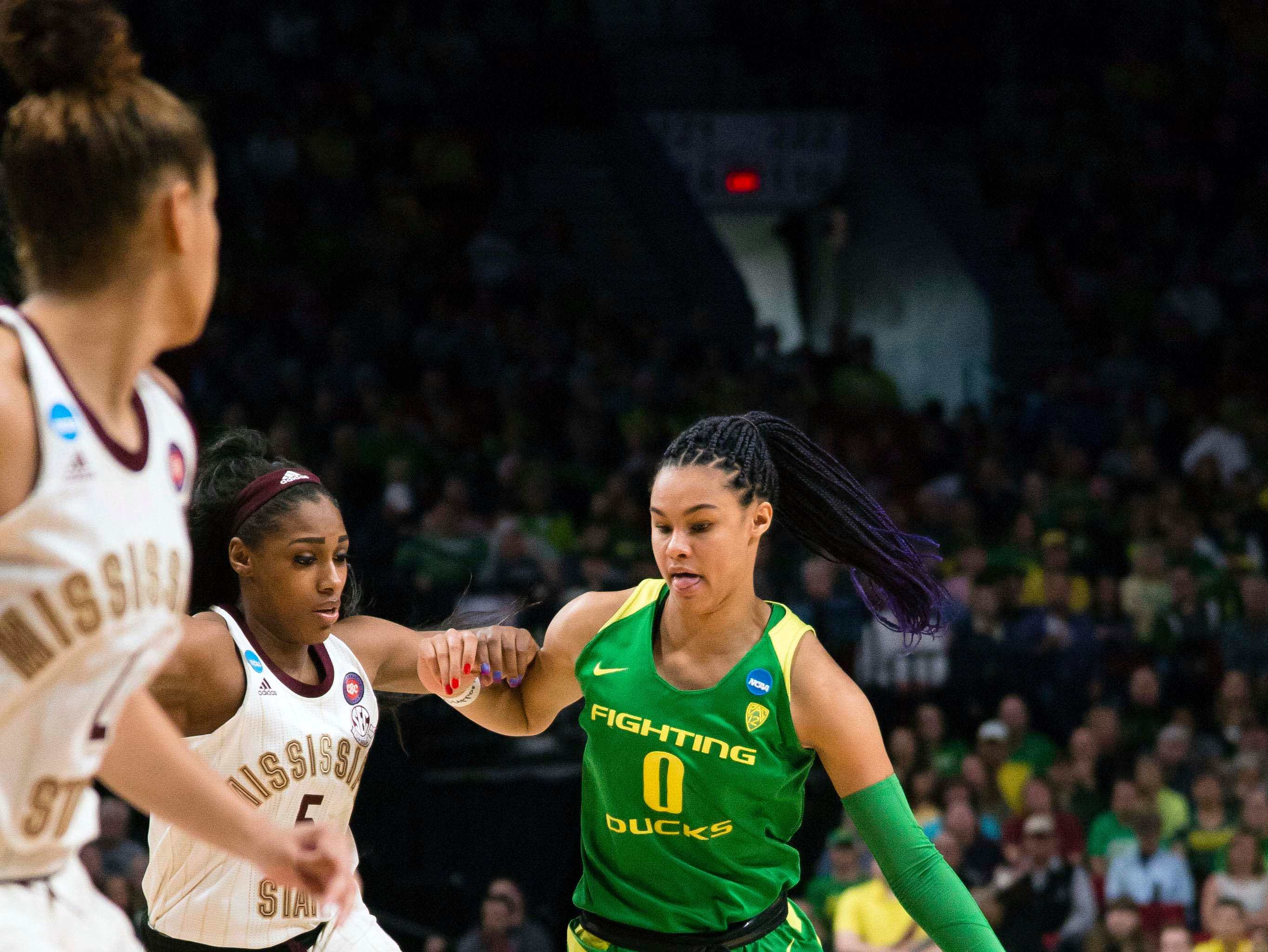 Oregon Ducks forward Satou Sabally (0) drives to the basket against Mississippi State Bulldogs forward Anriel Howard (5) during the first half in the championship game of the Portland regional in the women's 2019 NCAA Tournament at Moda Center.