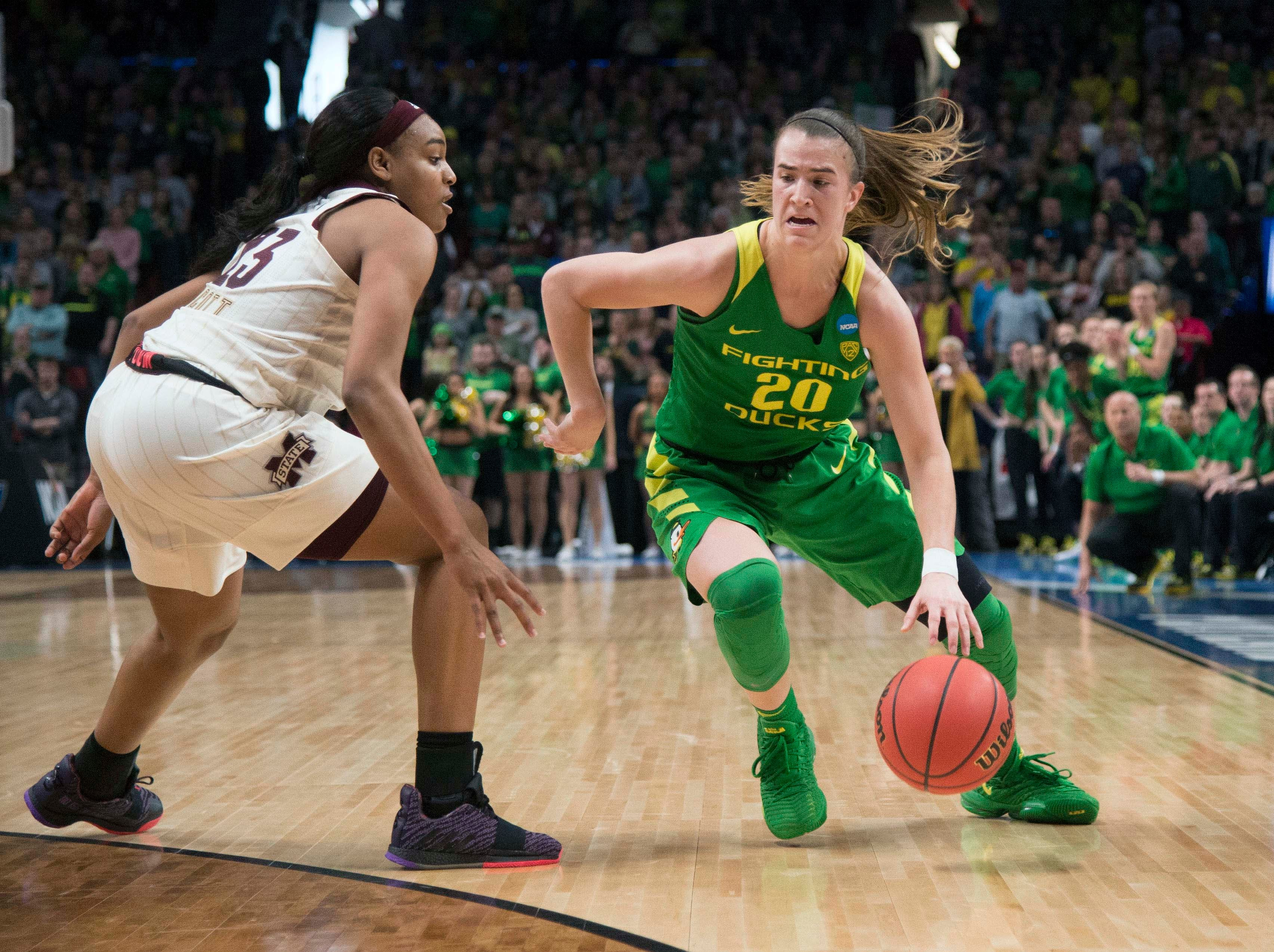 Oregon Ducks guard Sabrina Ionescu (20) drives to the basket against Mississippi State Bulldogs guard Bre'Amber Scott (23) during the first half in the championship game of the Portland regional in the women's 2019 NCAA Tournament at Moda Center.